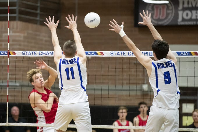 Senior opposite hitter Adam Ray (11) and senior middle blocker Shawn Roberts (9) of the Chandler Wolves look to block against the Mesa Mountain View Toros during the 6A Boys Volleyball State Championships at Higley High School on Saturday, May 11, 2019 in Gilbert, Arizona.