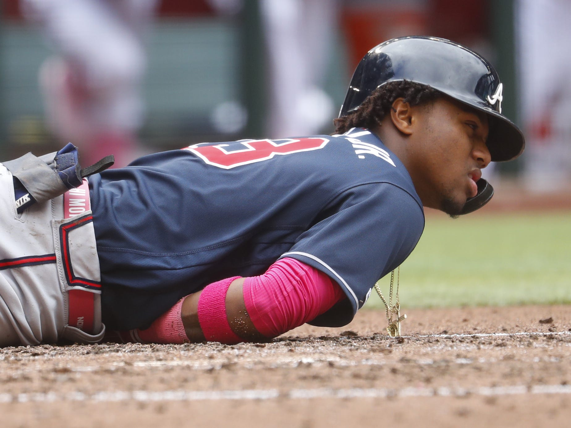 Braves' Ronald Acuna (13) lays on the ground after being hit by a pitch against the Diamondbacks at Chase Field in Phoenix, Ariz. on May 12, 2019.