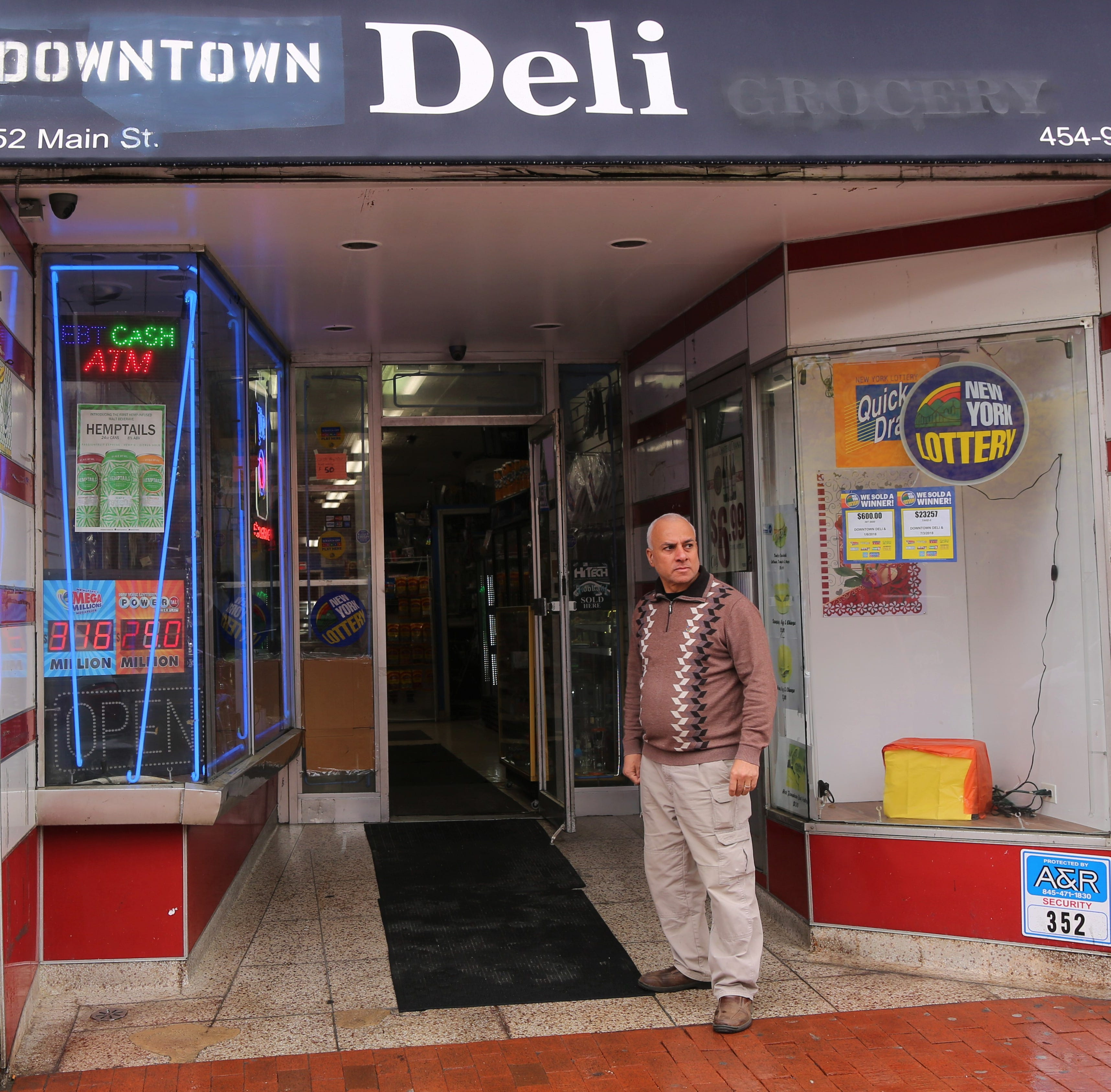 Osama Afifi stands outside his store Downtown Deli in the City of Poughkeepsie on May 12, 2019. On Tuesday, he was in his store when an upset customer shot a handgun at him, nearly hitting him.