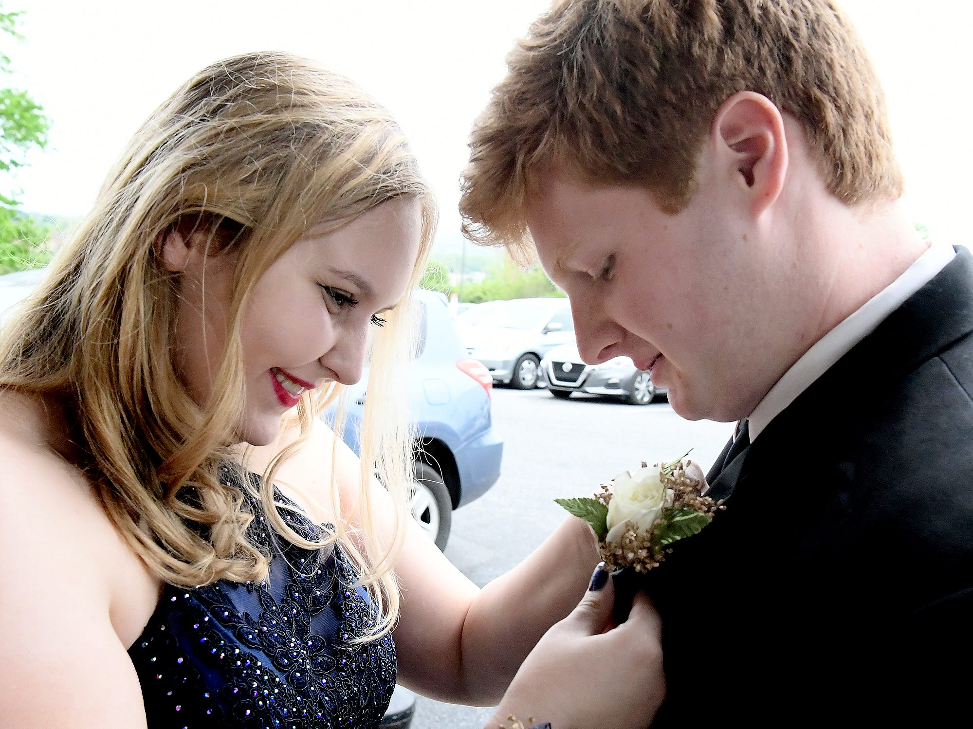 Alexis Sheffield helps Cole Archambeault with his wardrobe as they arrive at the Red Land High School Prom at Red Lion Hotel in Harrisburg Saturday, May 11, 2019. Bill Kalina photo