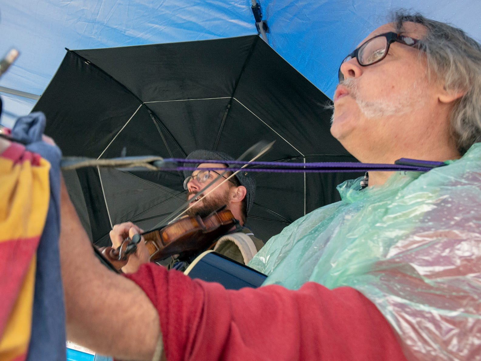 Musicians Ian Carroll and Ronn Benway perform on Continental Square during the 44th Annual Olde York Street Fair.