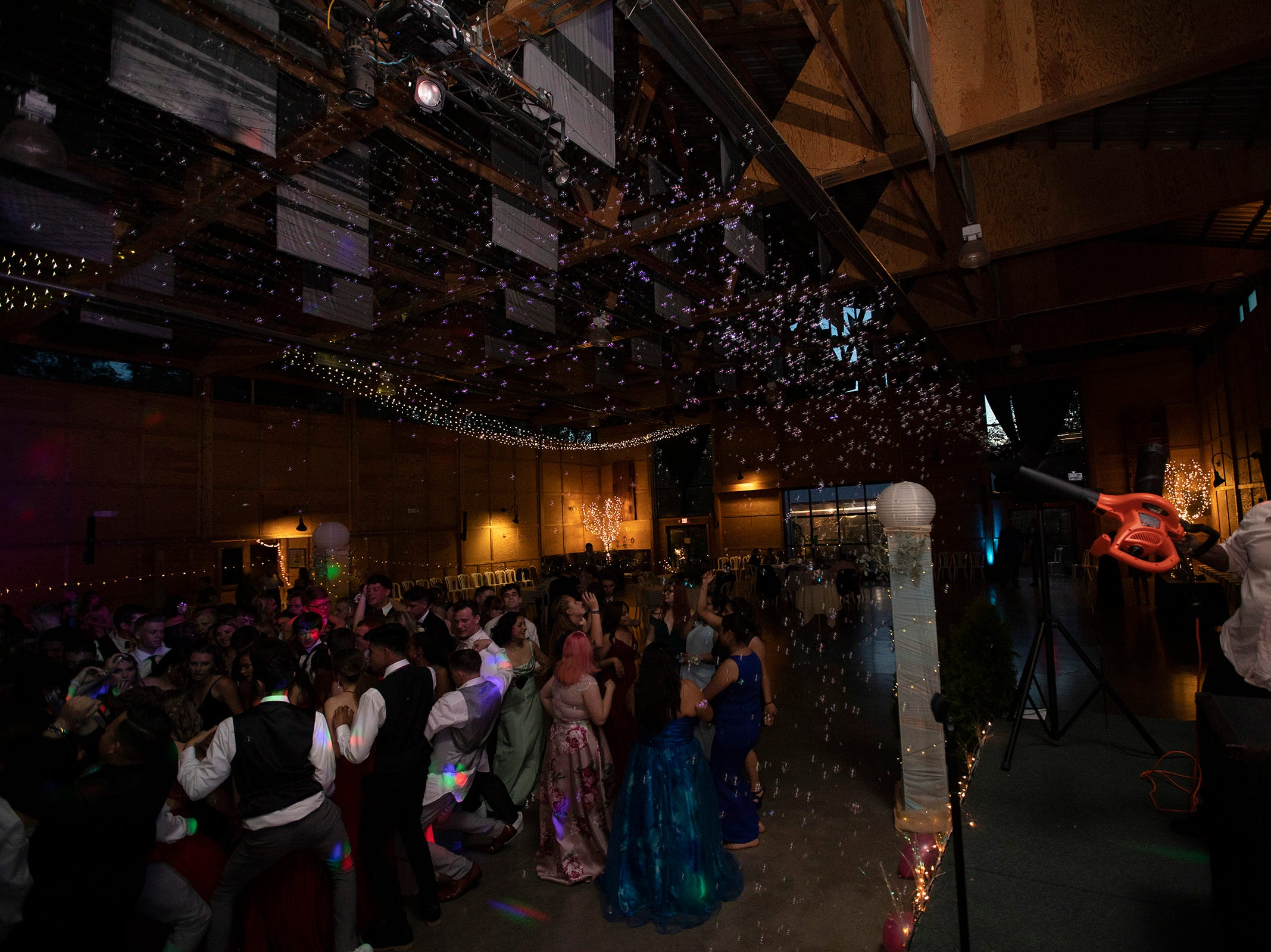 Bubbles are blown over the dance floor during the Silverton High School prom at the Oregon Garden on Saturday, May 11.
