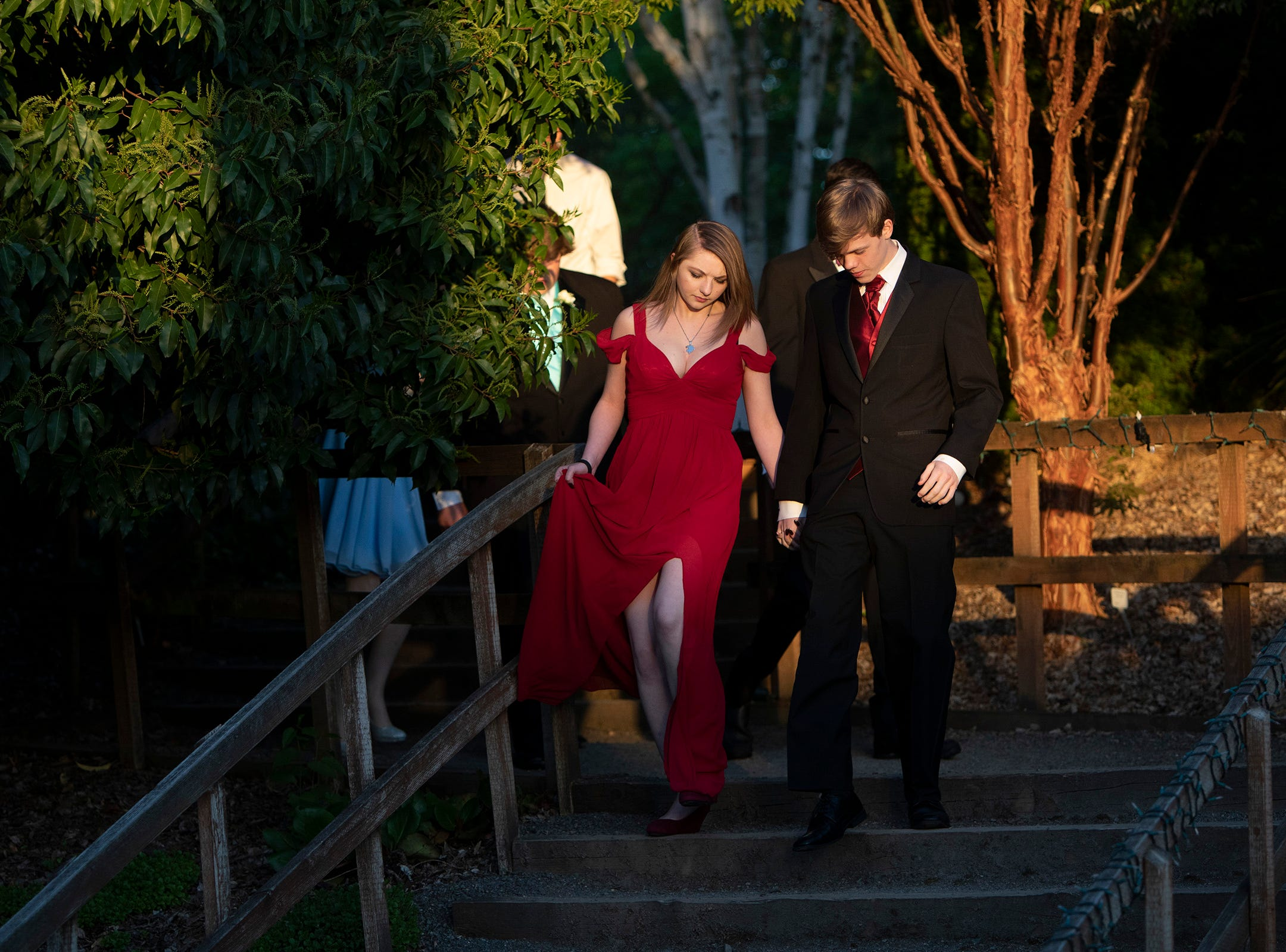 Kaleb Gribble, 17, and Serene Smith, 18, walk through the Oregon Garden grounds to the Silverton High School prom on Saturday, May 11.