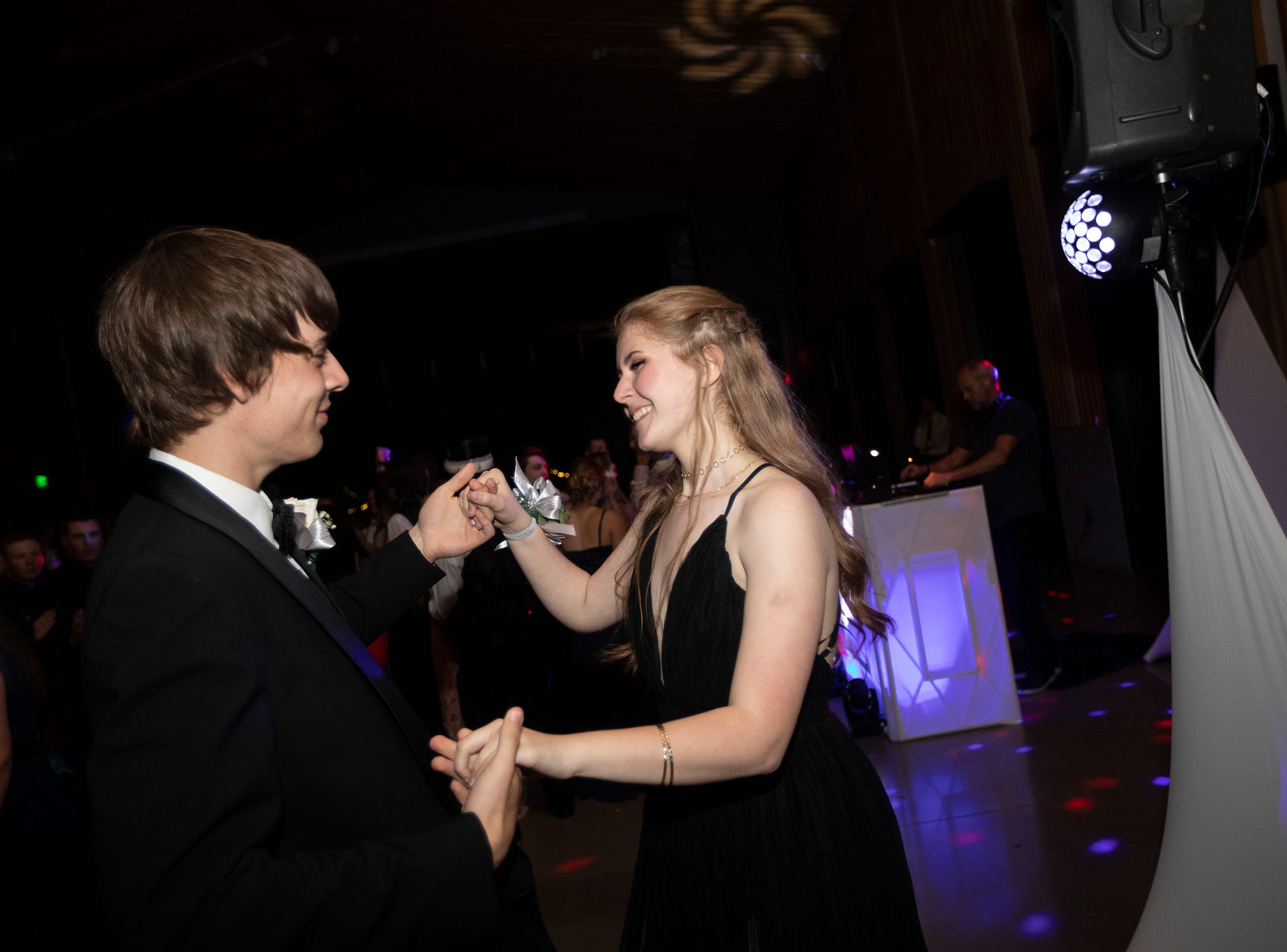 Kyle Mattson and Rylee Schaecher dance during the Dallas High School prom at the Dallas Armory on Saturday, May 12.