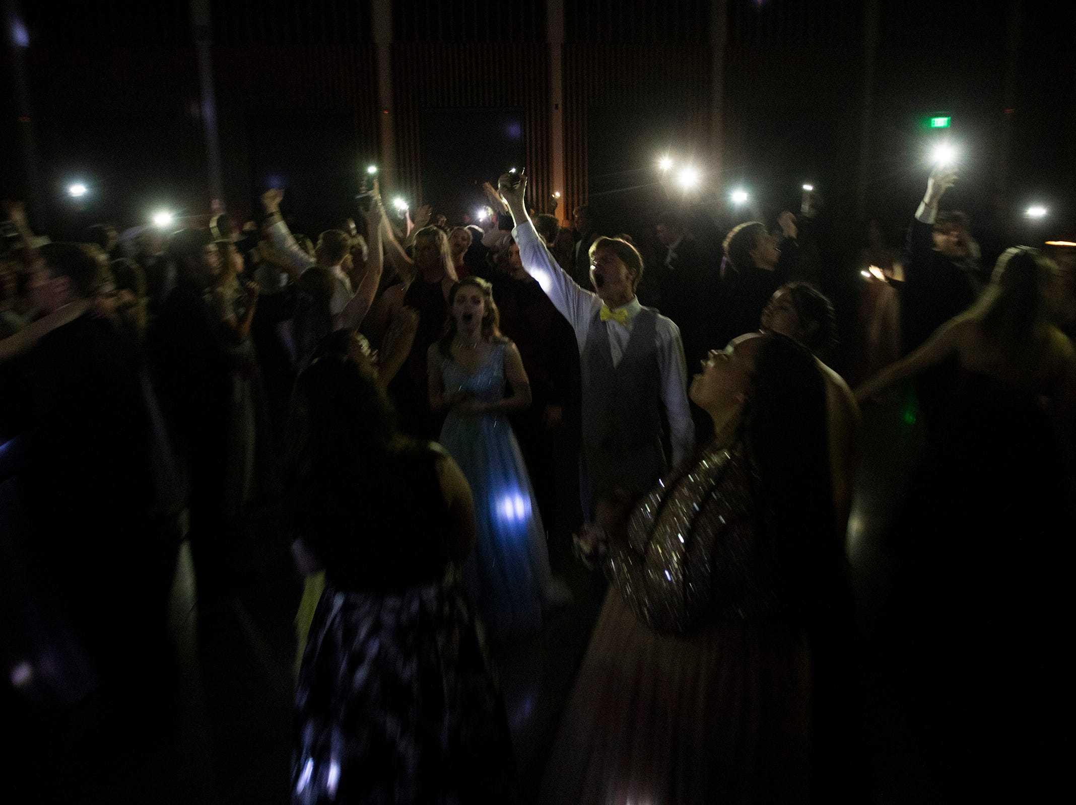 Students dance during the Dallas High School prom at the Dallas Armory on Saturday, May 12.