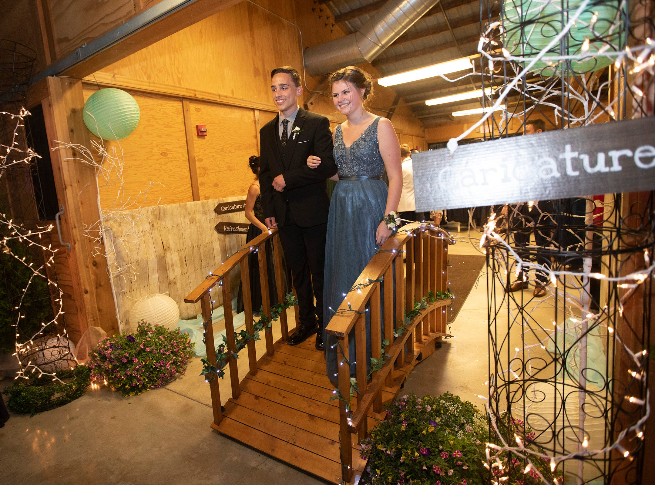 Zachary Stutzman, 17, and Taylor Schornstein, 17, pose for a photo while walking into the Silverton High School  prom at the Oregon Garden on Saturday, May 11.