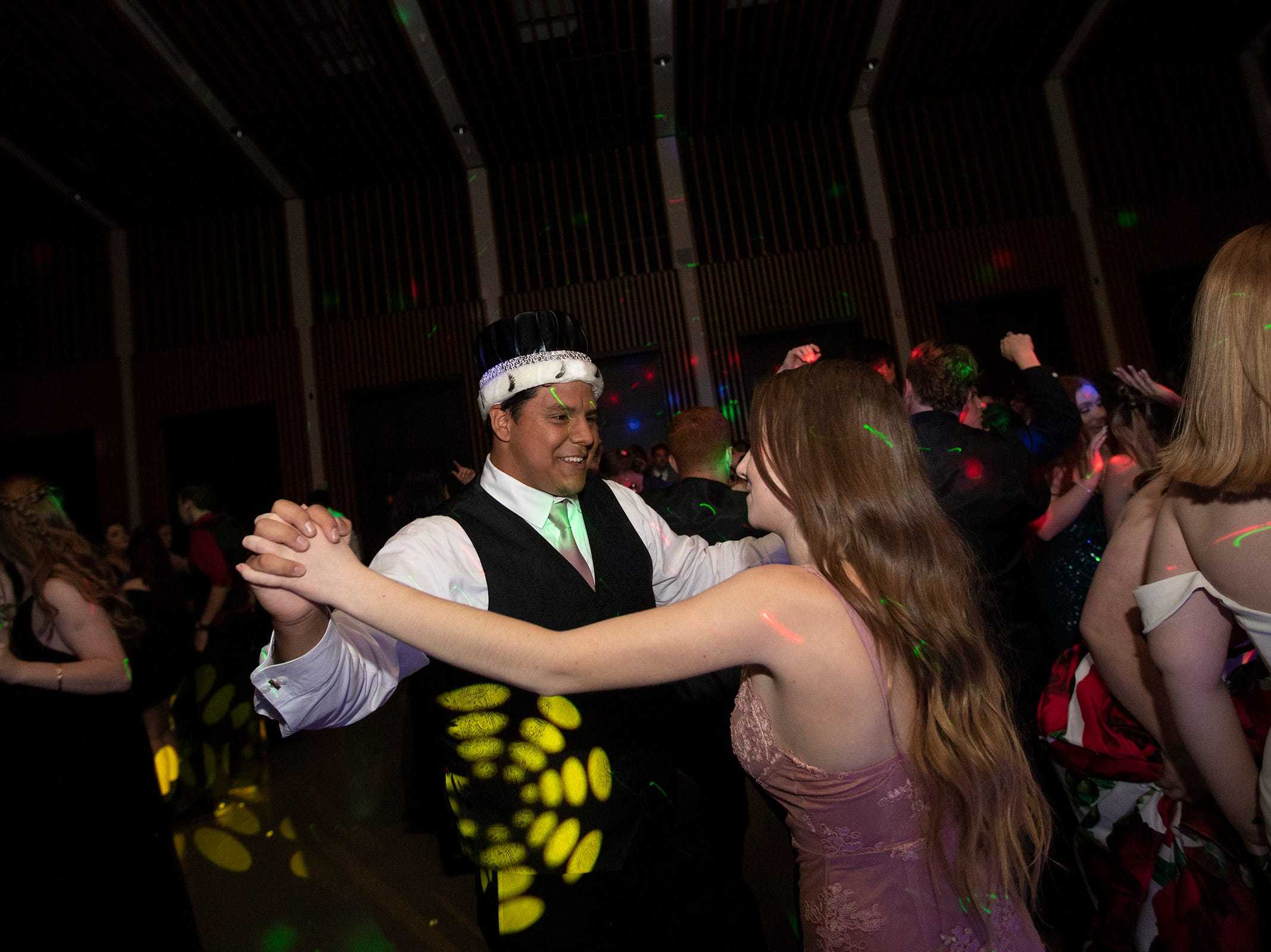 Prom king Thomas Rocha and Meredith Oace dance during the Dallas High School prom at the Dallas Armory on Saturday, May 12.