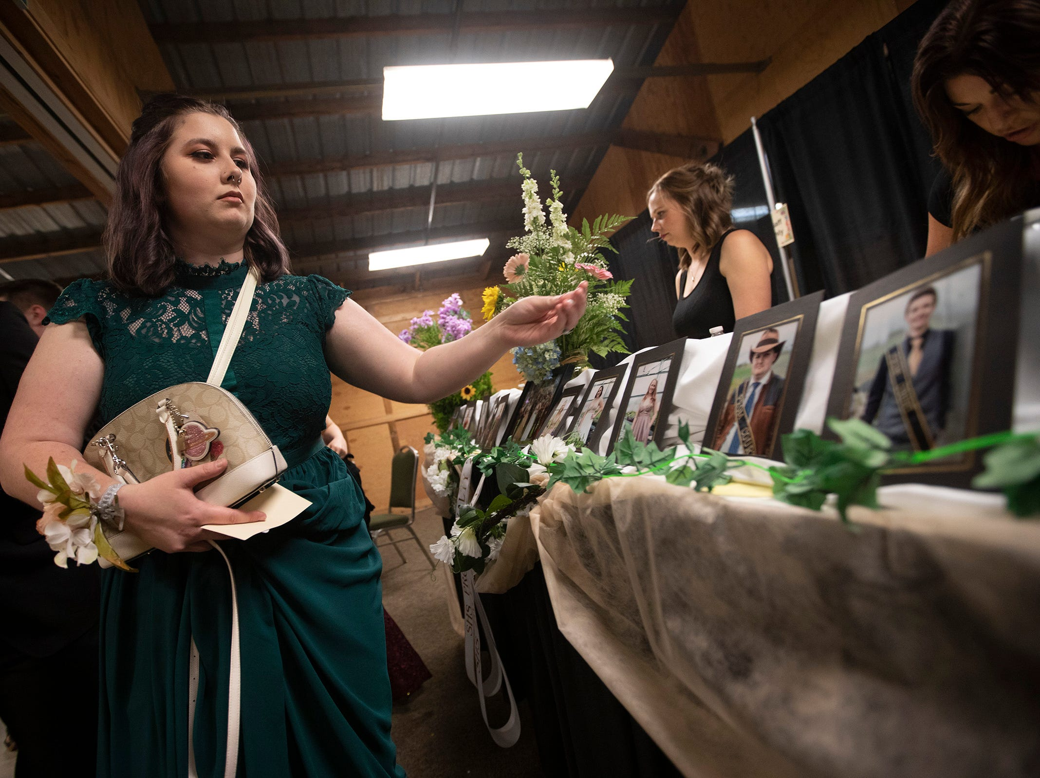 Camryn Davis, 18, casts her votes for prom court during the Silverton High School prom at the Oregon Garden on Saturday, May 11.