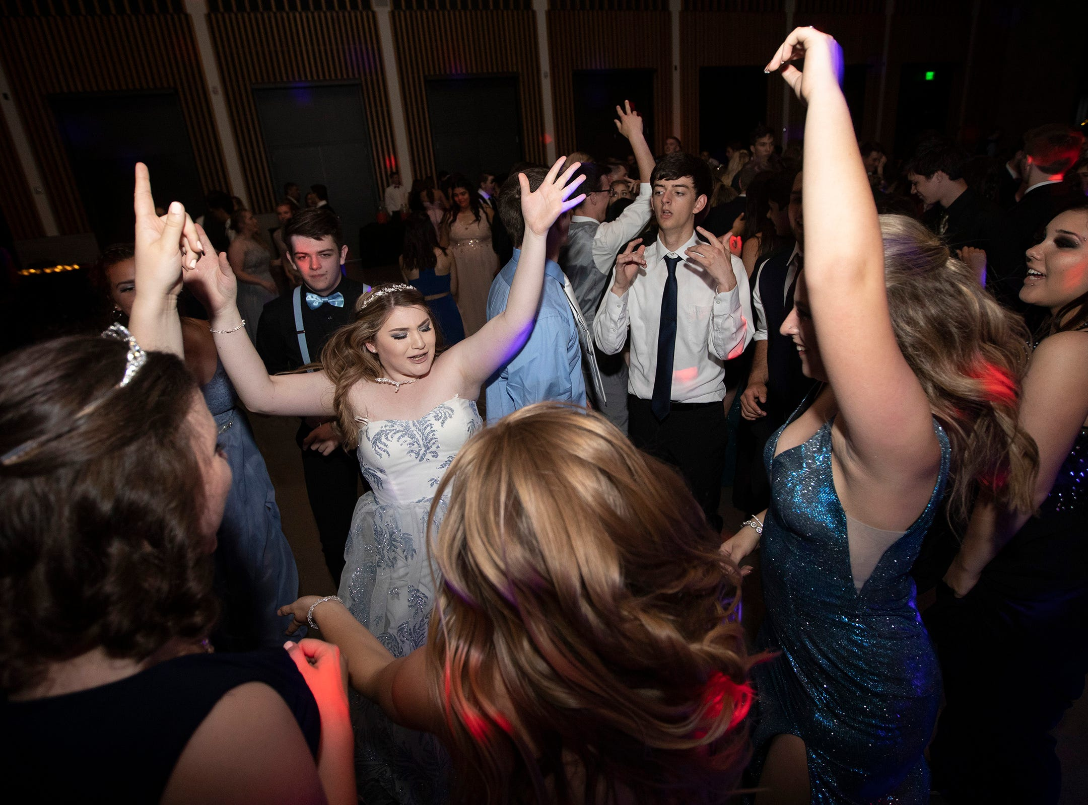 Morgan McCarley dances with friends during the Dallas High School prom at the Dallas Armory on Saturday, May 12.