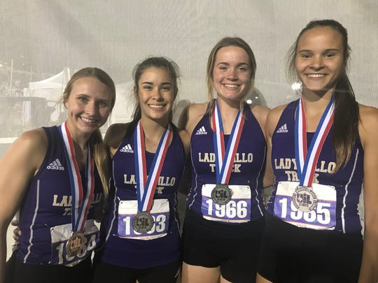 San Saba's Ashlynn Cash, Brighton Adams, Kylee Eckermann and Courtnee Cash show their silver medals from the 2A girls 4x400 relay Saturday May 11, 2019 at the UIL State Track and Field Championships.