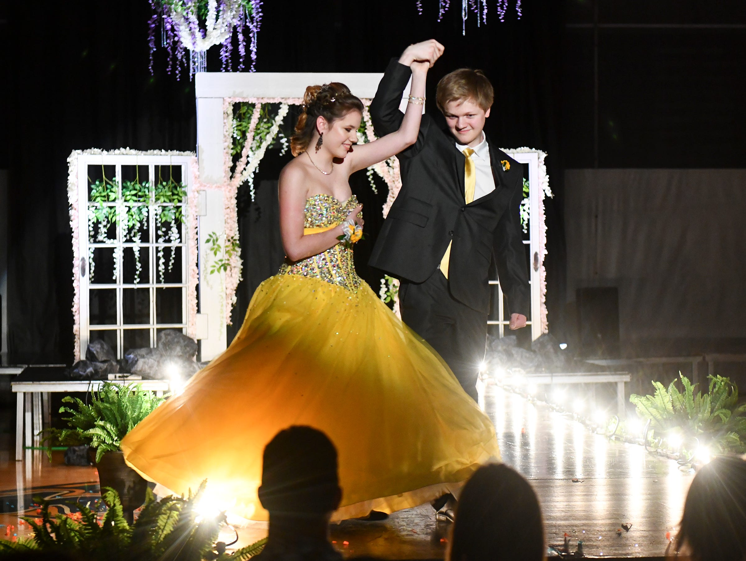 A couple does a twirl during their turn at prom grand march Saturday, May 11, at Sauk Rapids-Rice High School.
