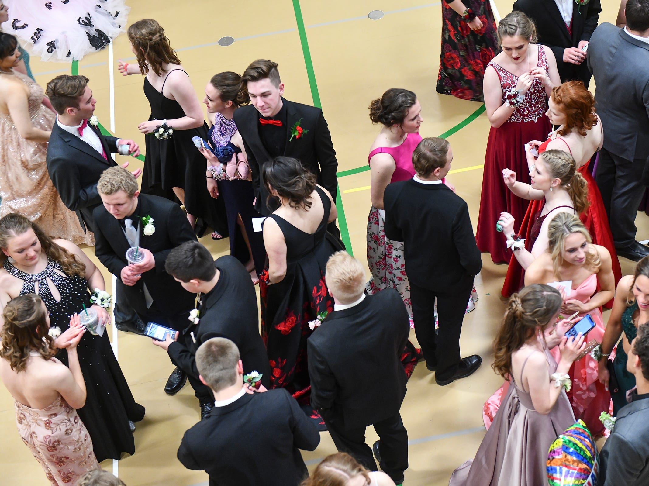 Promgoers gather before the start of prom grand march Saturday, May 11, at Sauk Rapids-Rice High School.