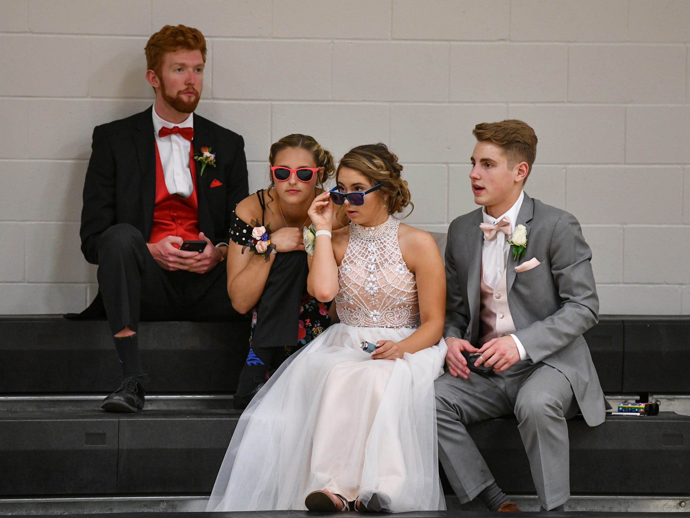Mitchell Lochner, Halie Kipka, Abby Trelfa and Dan Fleigle wait for grand march to start Saturday, May 11, at Sauk Rapids-Rice High School.