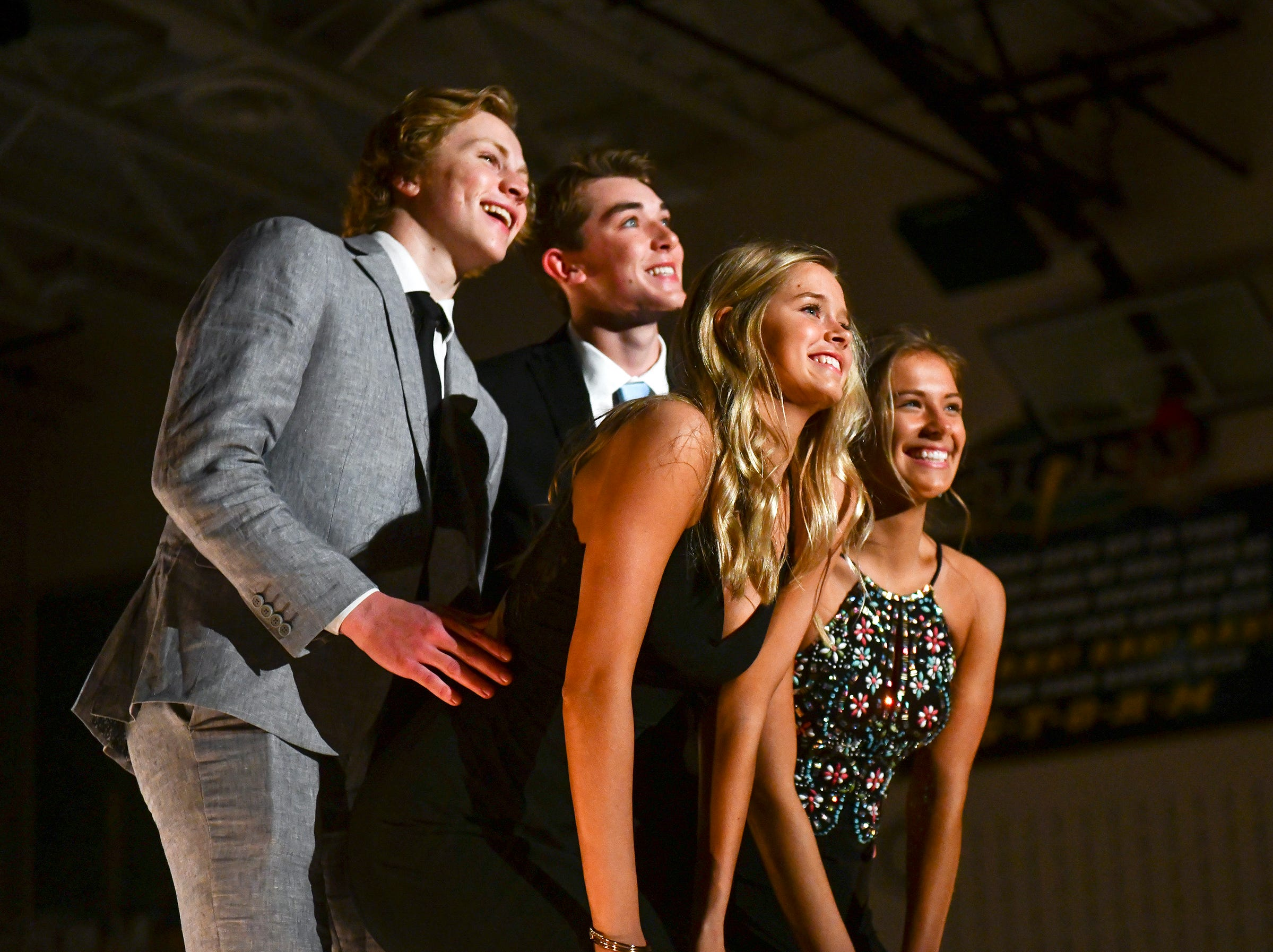 Friends smile during prom grand march Saturday, May 11, at Sauk Rapids-Rice High School.