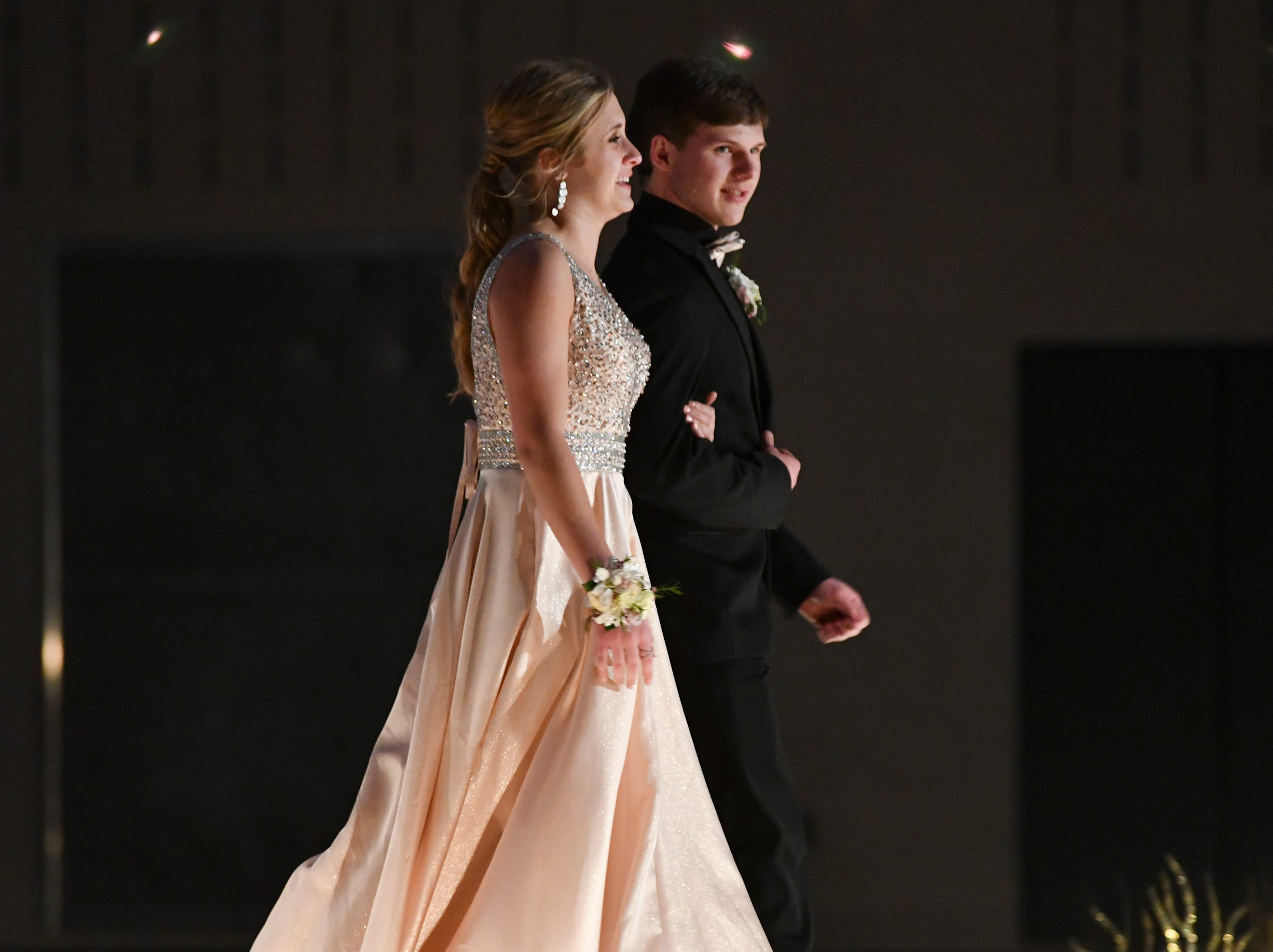 A couple makes their way down the runway during prom grand march Saturday, May 11, at Sauk Rapids-Rice High School.