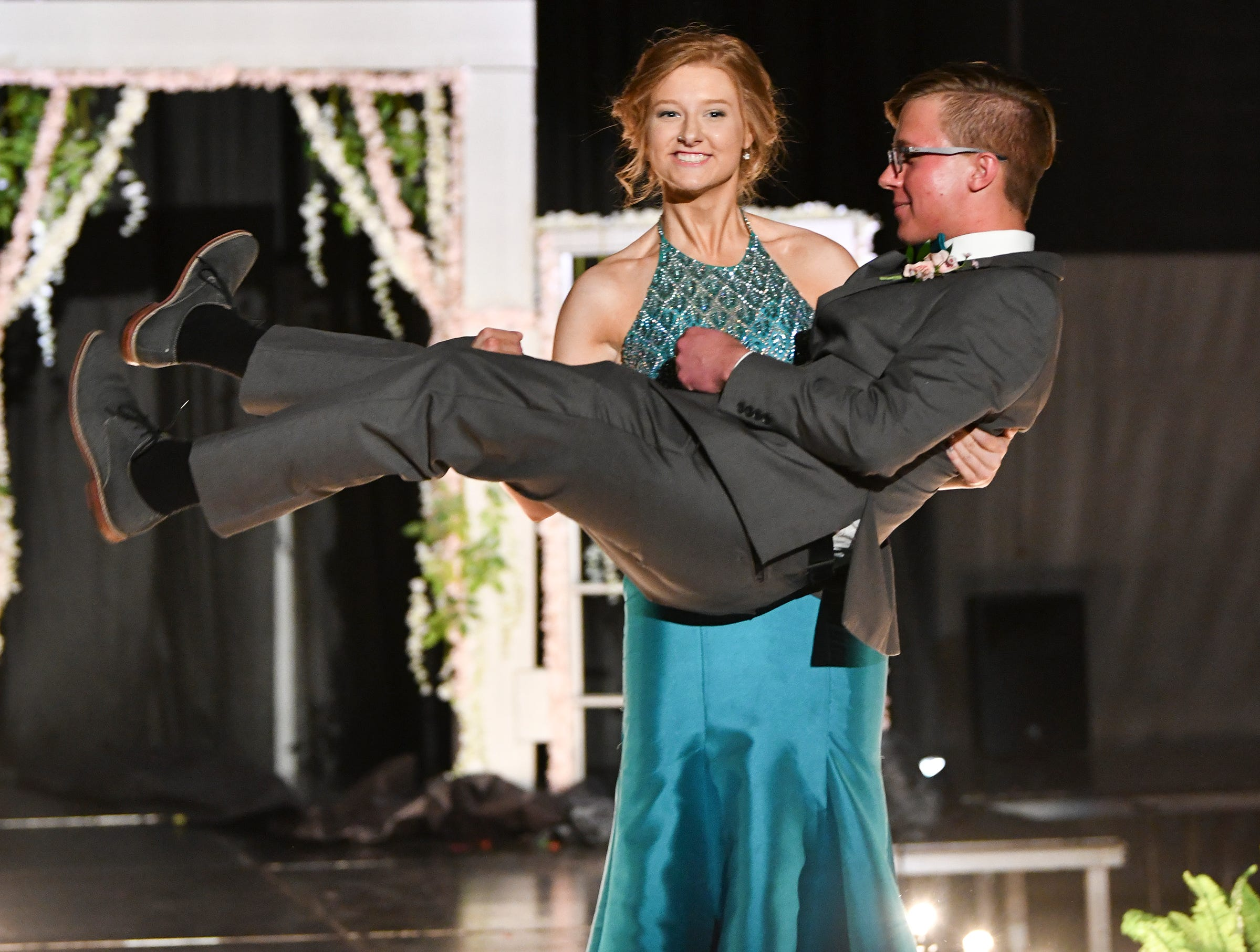 A couple strikes a pose during prom grand march Saturday, May 11, at Sauk Rapids-Rice High School.