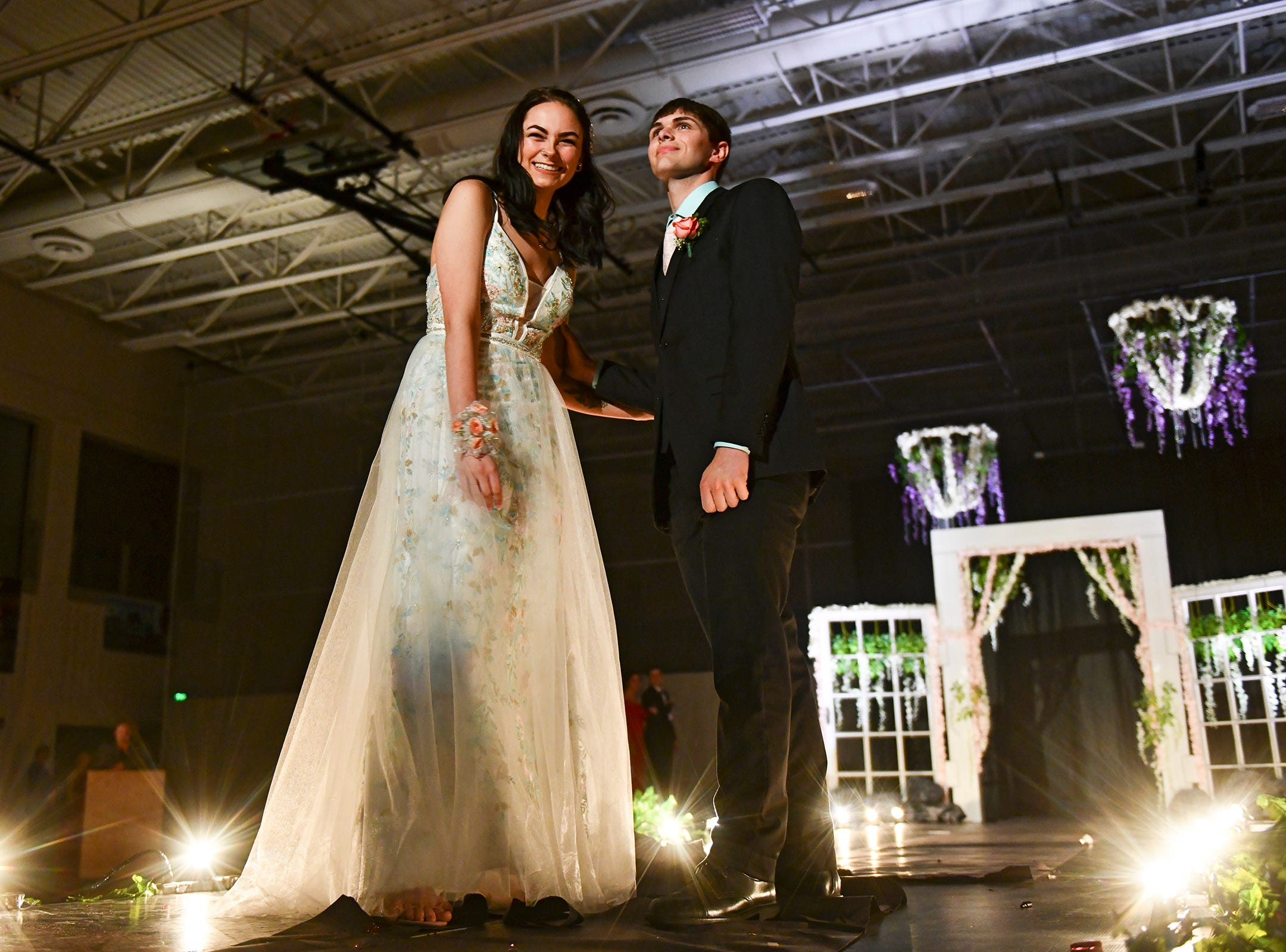 Couples take their turn on the runway during prom grand march Saturday, May 11, at Sauk Rapids-Rice High School.
