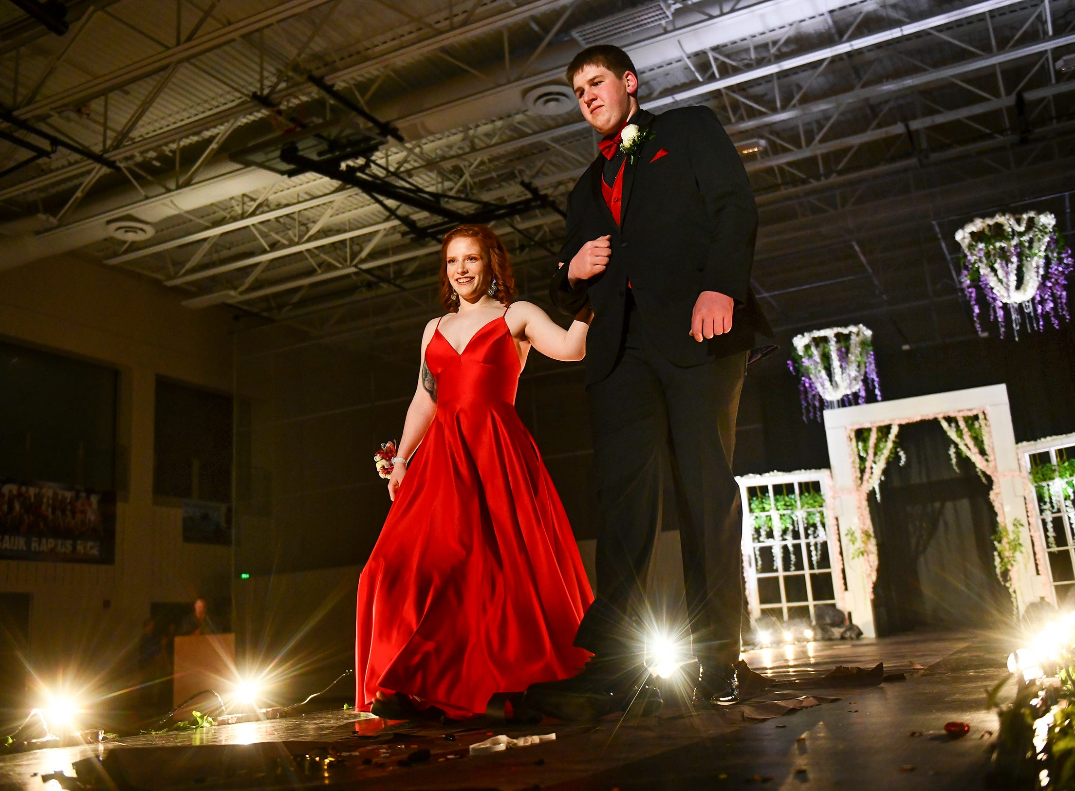 A couple takes center stage during prom grand march Saturday, May 11, at Sauk Rapids-Rice High School.