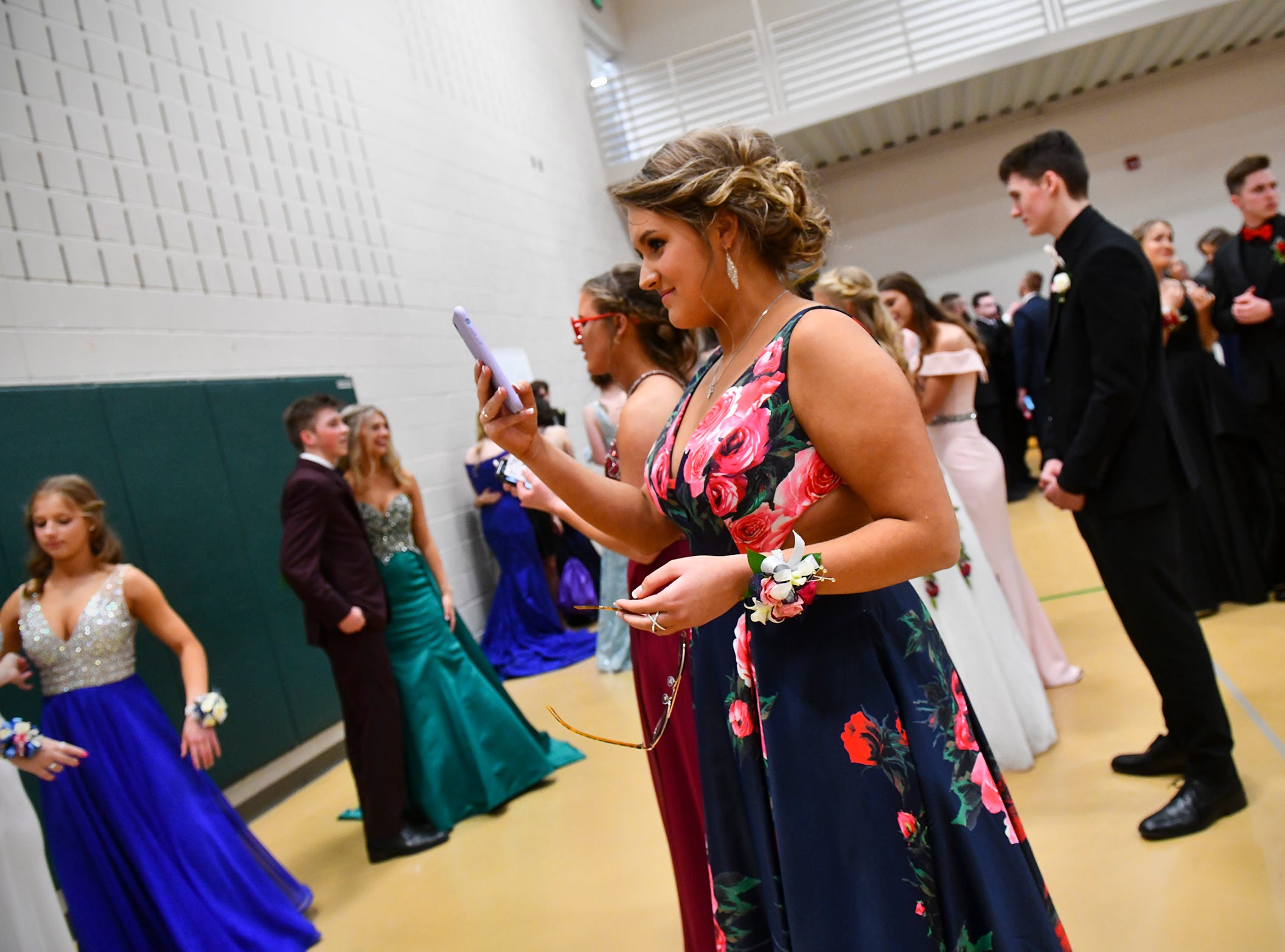Promgoers pose for photos before the start of prom grand march Saturday, May 11, at Sauk Rapids-Rice High School.