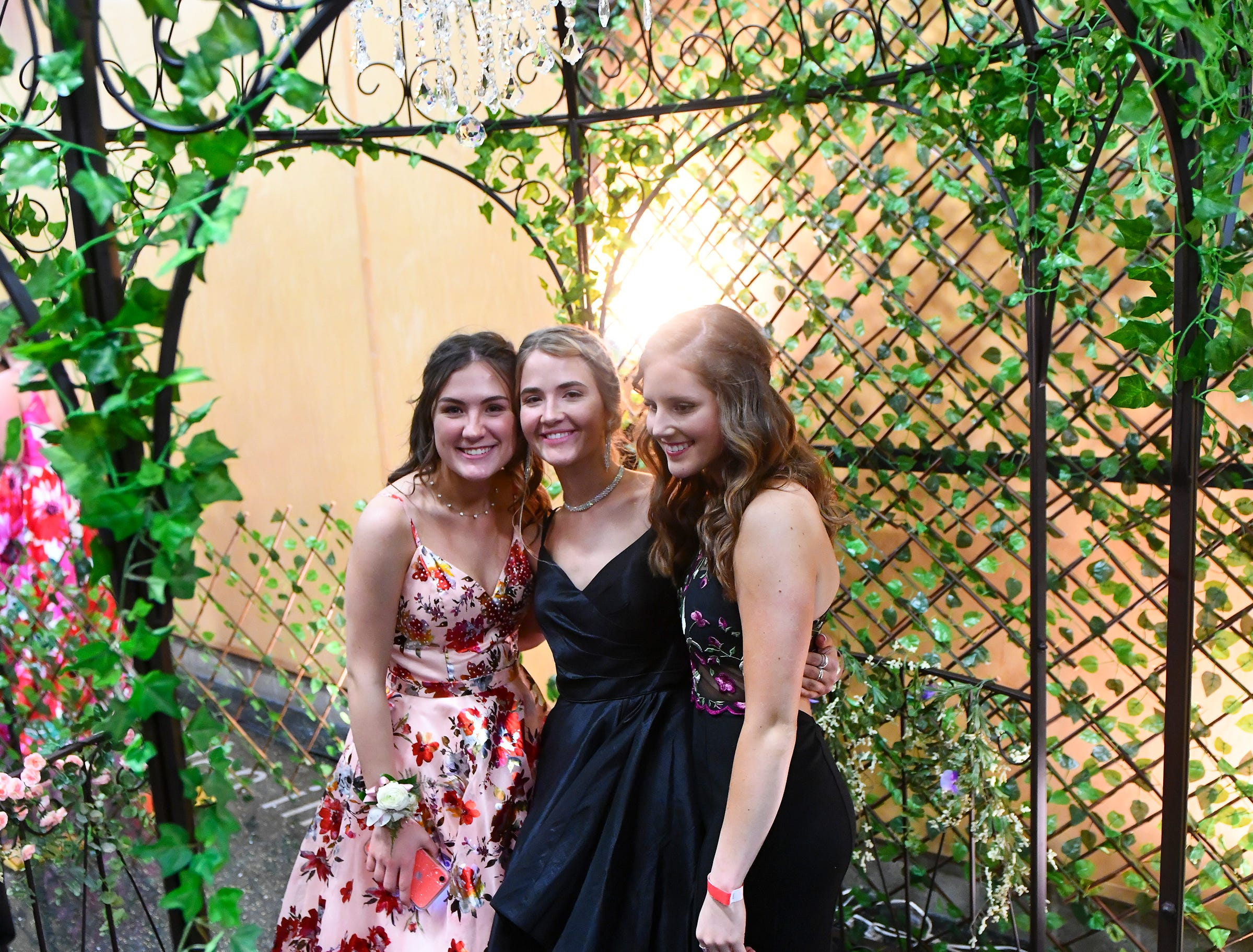 Hannah Guhlke, Makenzi Hader and Maia Hanbrouck pose for photos under a gazebo following prom grand march Saturday, May 11, at Sauk Rapids-Rice High School.