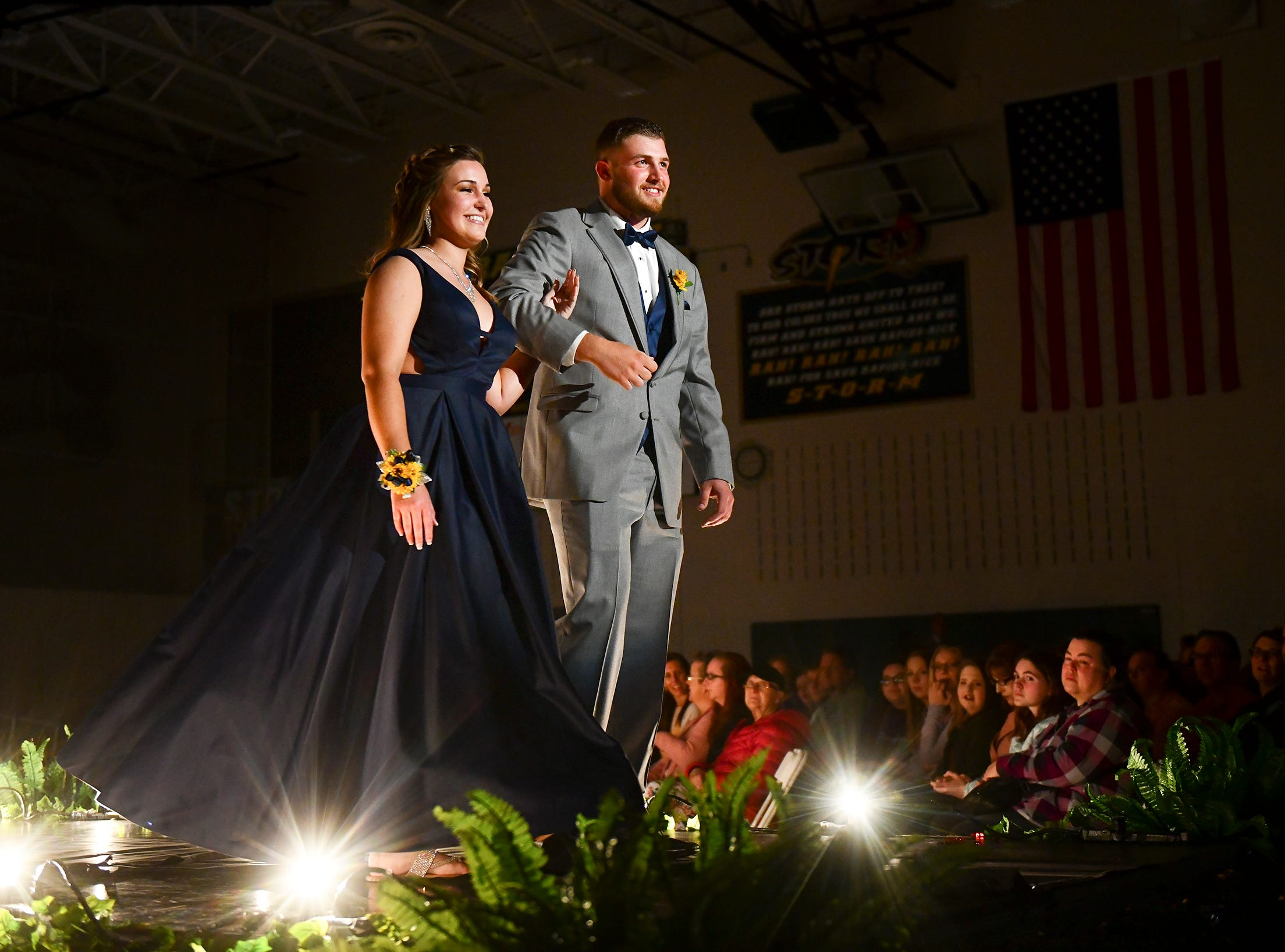 Couples smile at the end of the walkway during prom grand march Saturday, May 11, at Sauk Rapids-Rice High School.