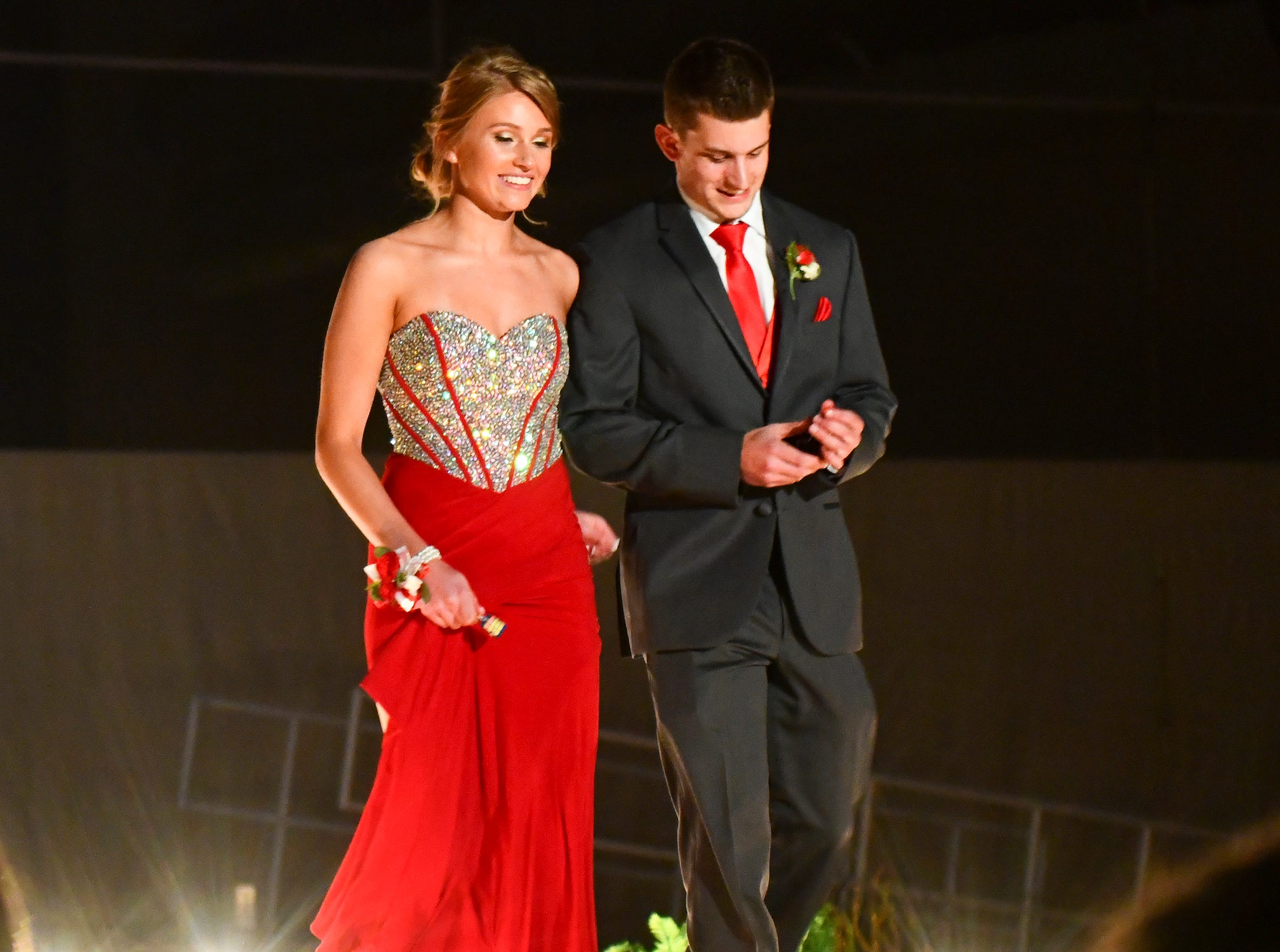 Spotlights illuminate a couple during prom grand march Saturday, May 11, at Sauk Rapids-Rice High School.