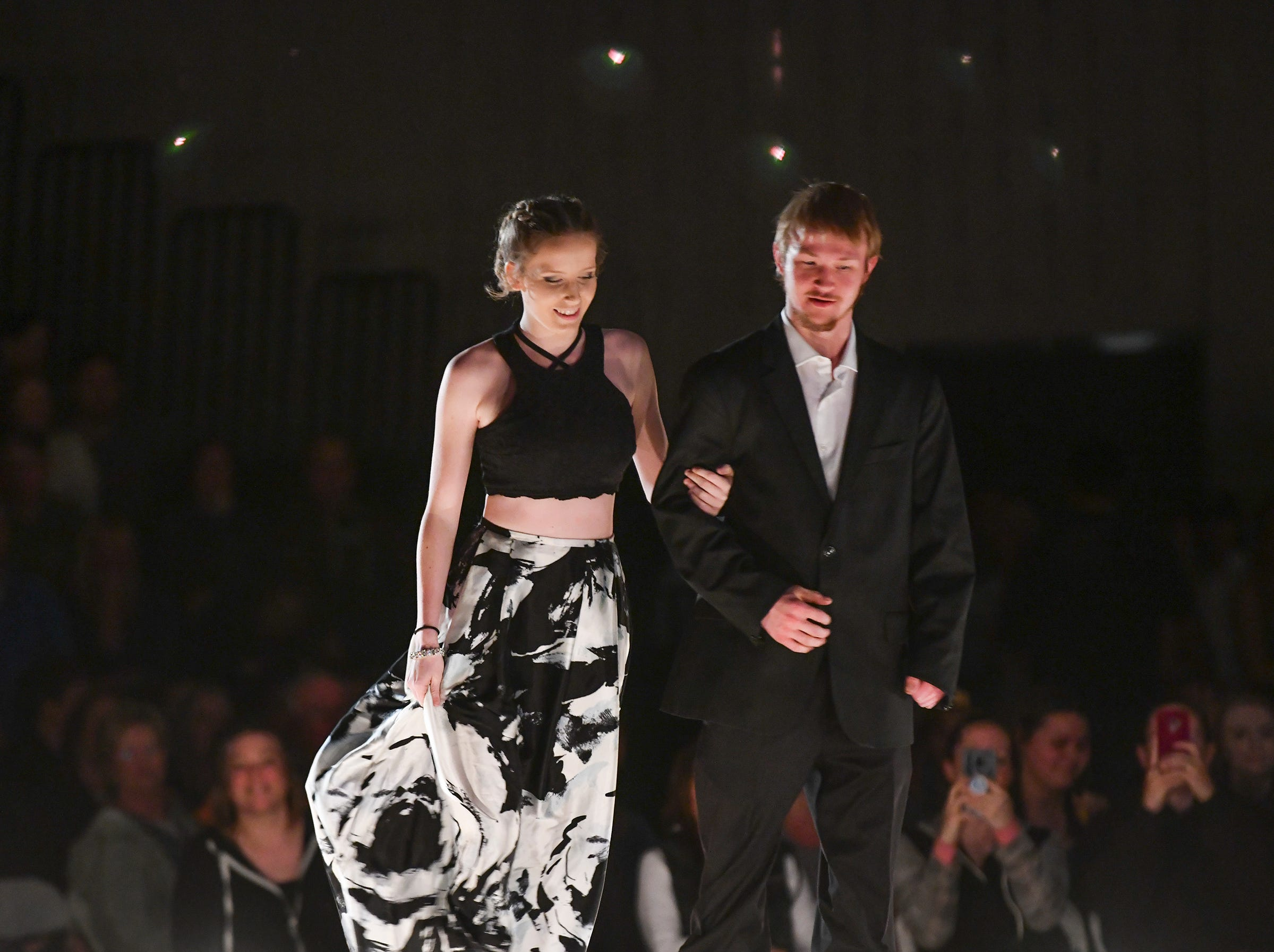 A couple walks the runway during prom grand march Saturday, May 11, at Sauk Rapids-Rice High School.