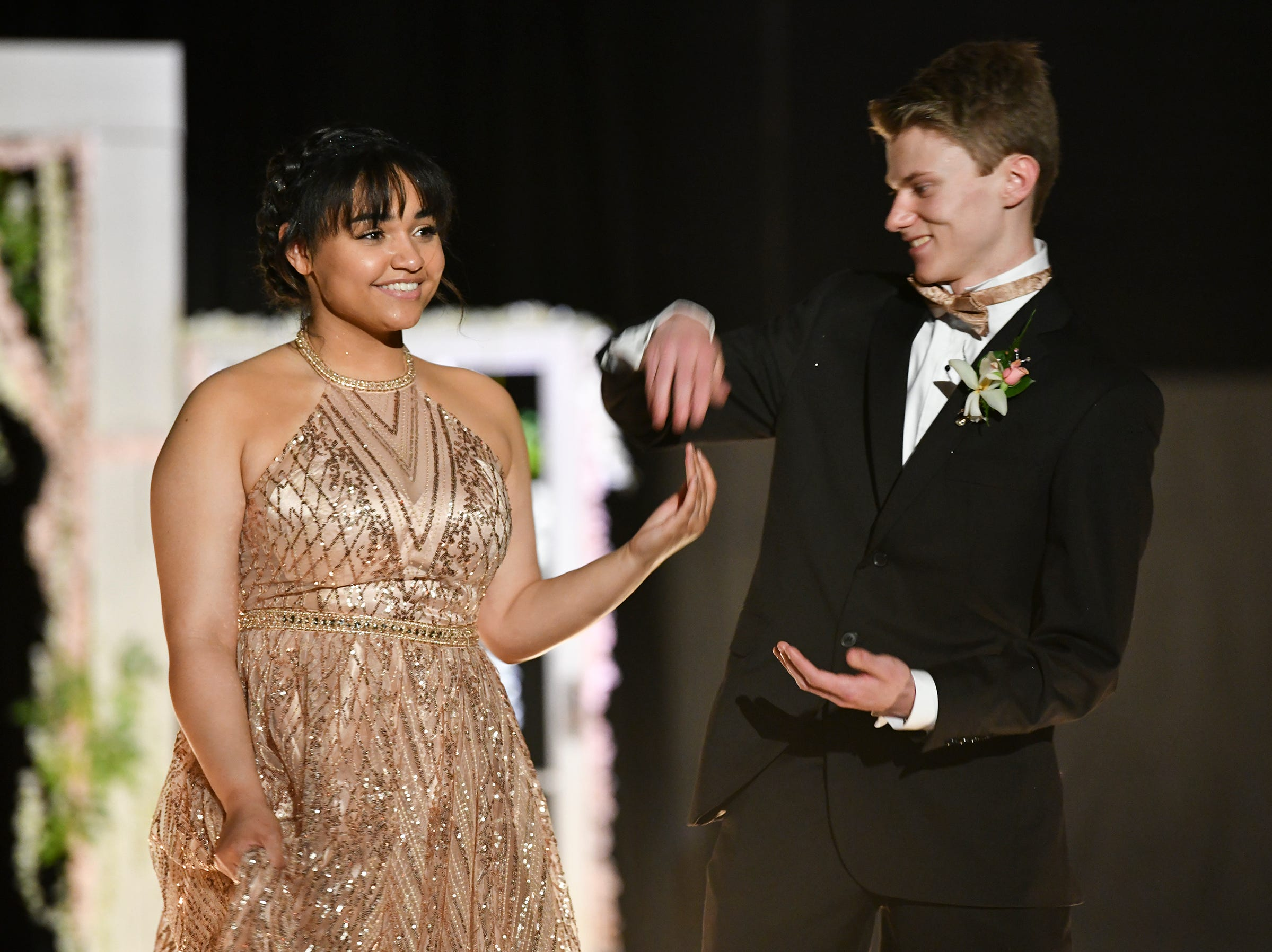 Couples strike a pose at the end of the runway during prom grand march Saturday, May 11, at Sauk Rapids-Rice High School.