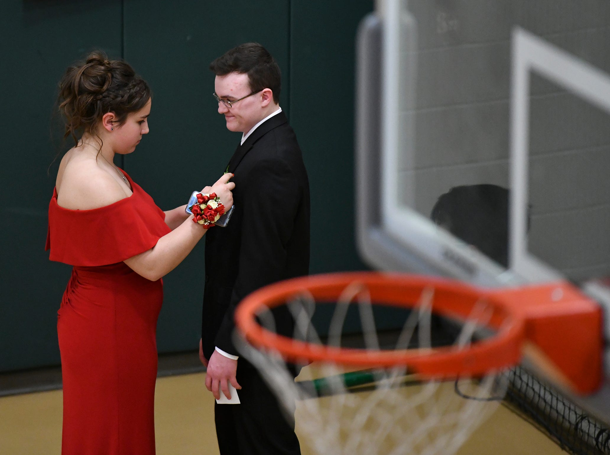 Students take care of the final details before starting the prom grand march Saturday, May 11, at Sauk Rapids-Rice High School.