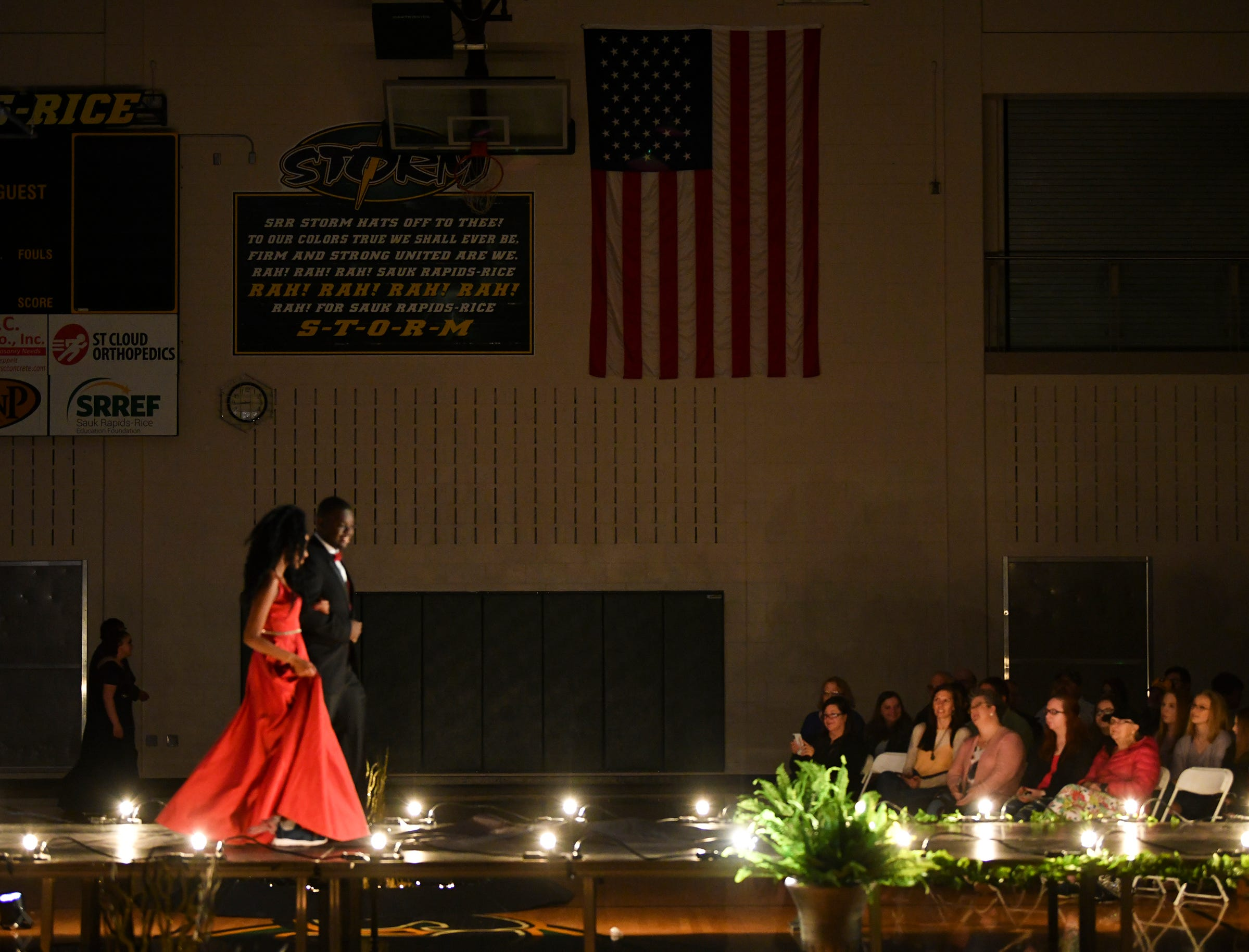Couples make their way down the runway during prom grand march Saturday, May 11, at Sauk Rapids-Rice High School.