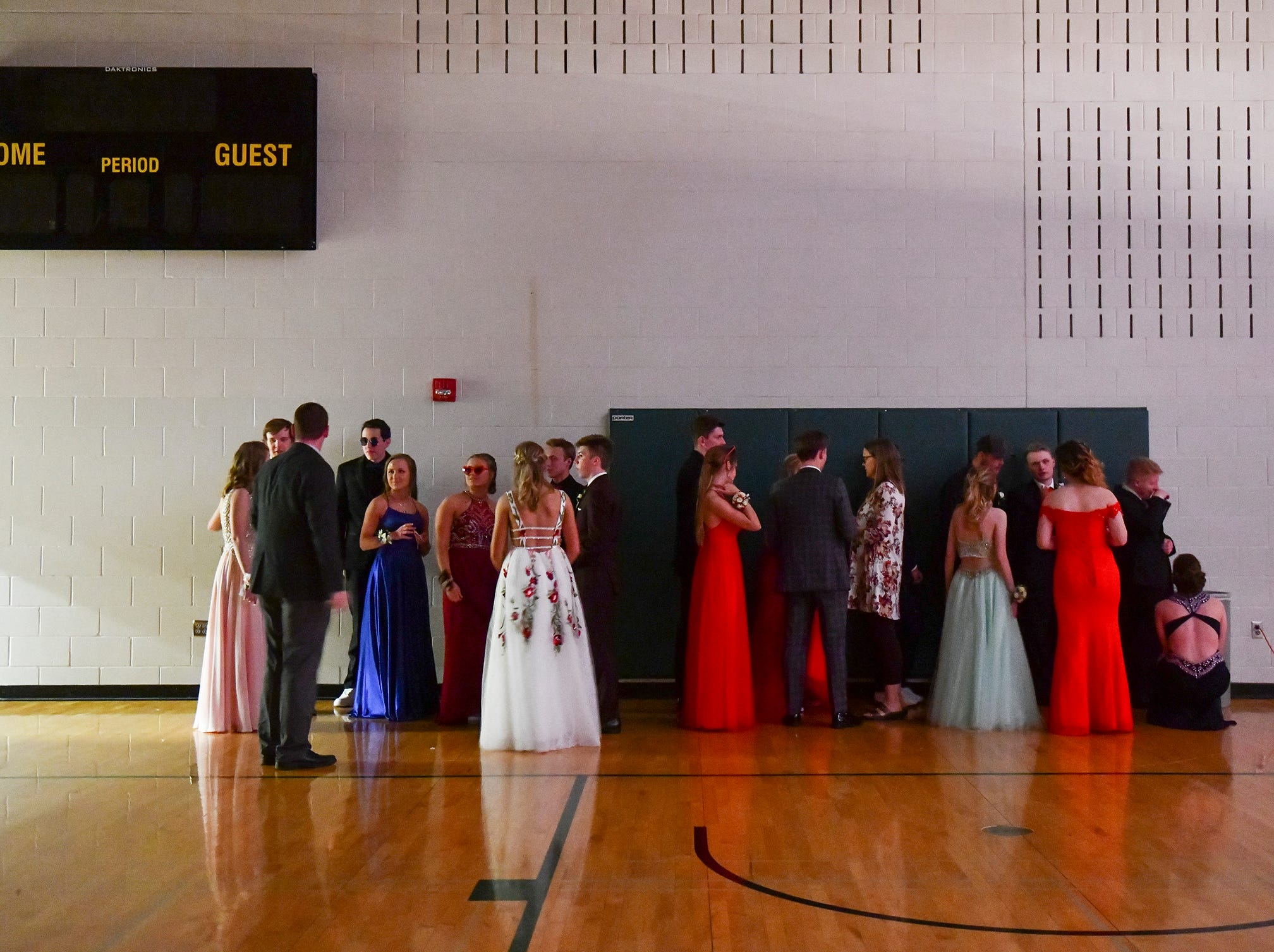 Couples line up behind the scenes for their turn at prom grand march Saturday, May 11, at Sauk Rapids-Rice High School.