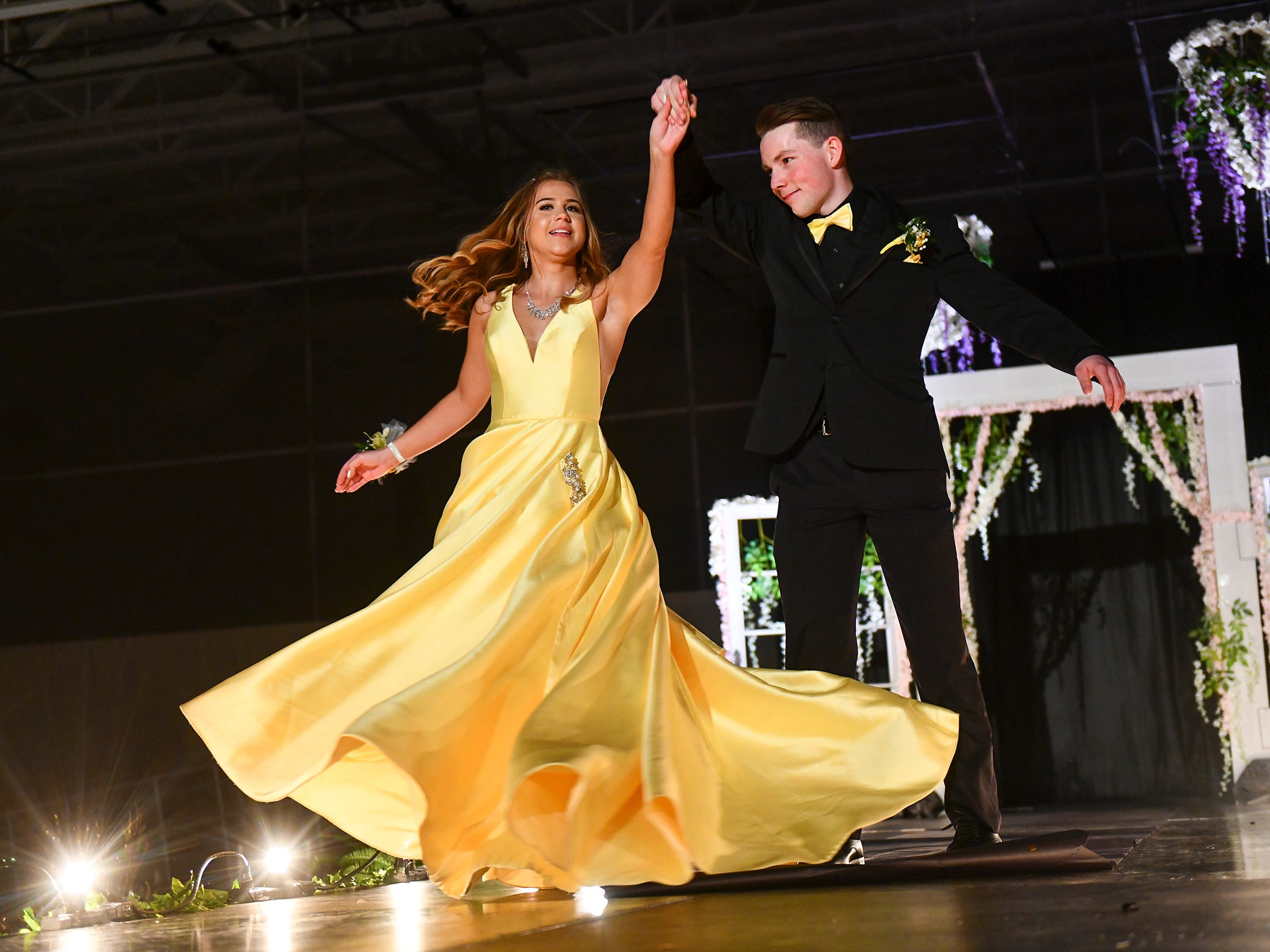 A couple twirls at the end of the runway during prom grand march Saturday, May 11, at Sauk Rapids-Rice High School.