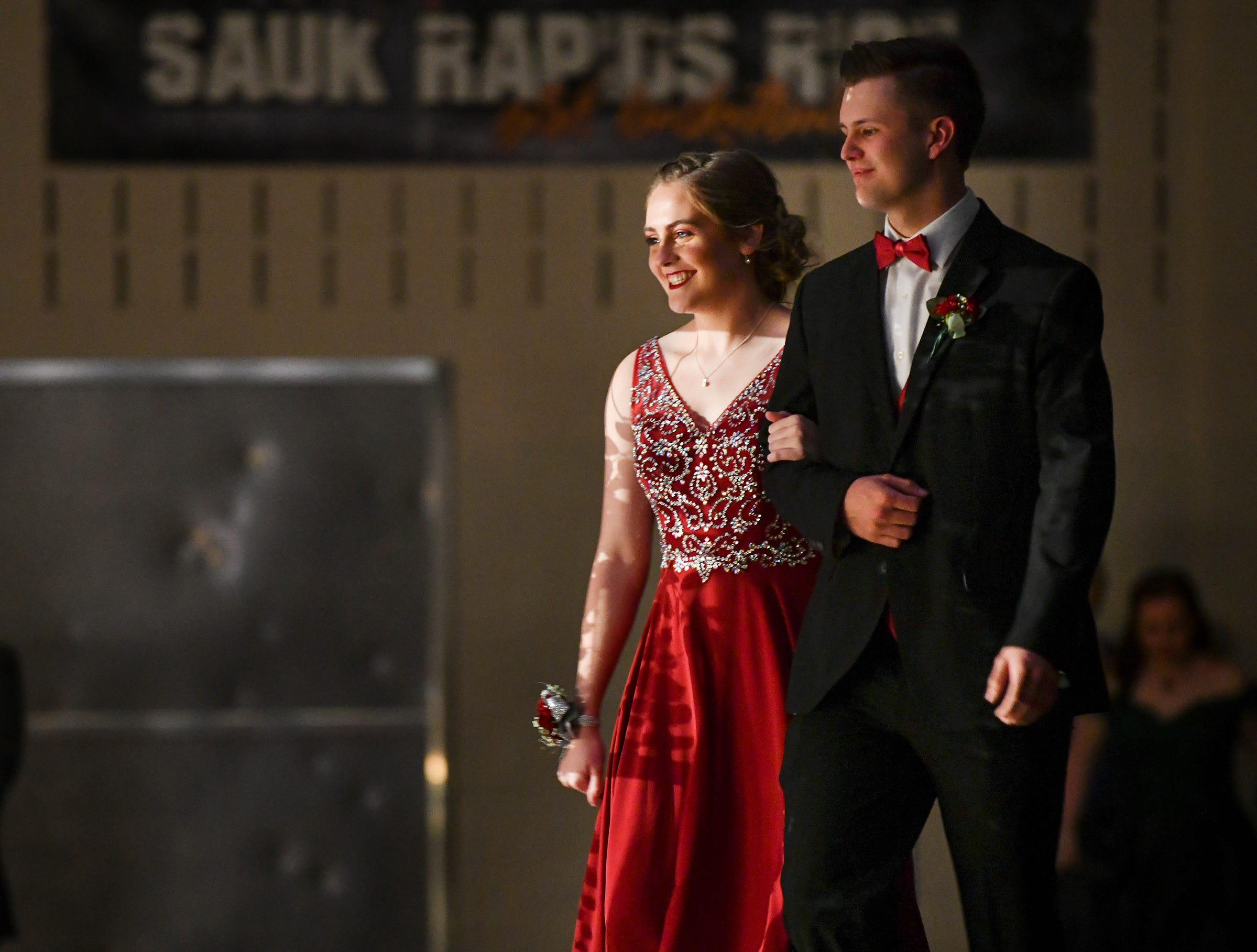 A couple smiles during prom grand march Saturday, May 11, at Sauk Rapids-Rice High School.