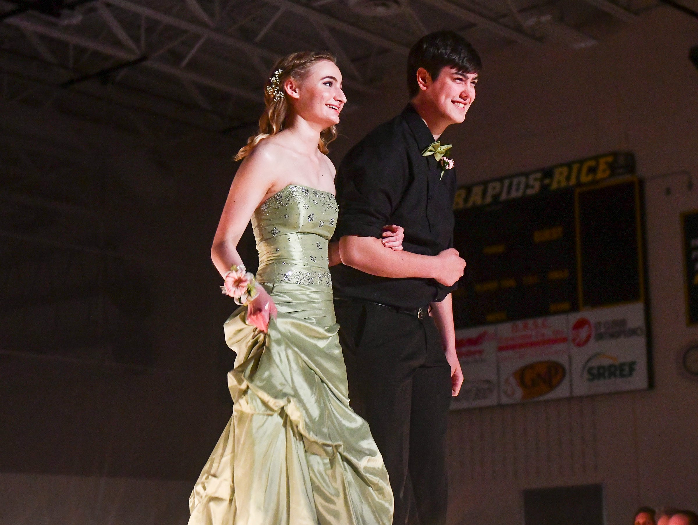Couples take their turns in the spotlight during prom grand march Saturday, May 11, at Sauk Rapids-Rice High School.