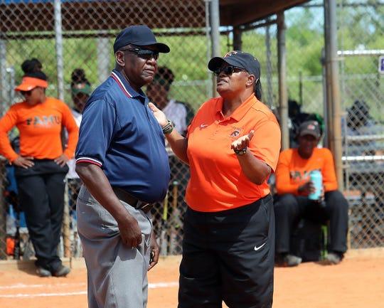 FAMU softball head coach Veronica Wiggins talks with an umpire between innings during the 2019 MEAC Softball Tournament.