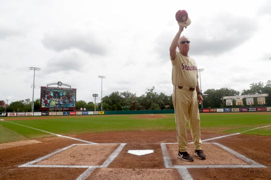 Florida State University Head Baseball Coach Mike Martin tips his hat to the crowd at Dick Howser Stadium and the field that bears his name as he is recognized during his last home game after 40 seasons Sunday, May 12, 2019.