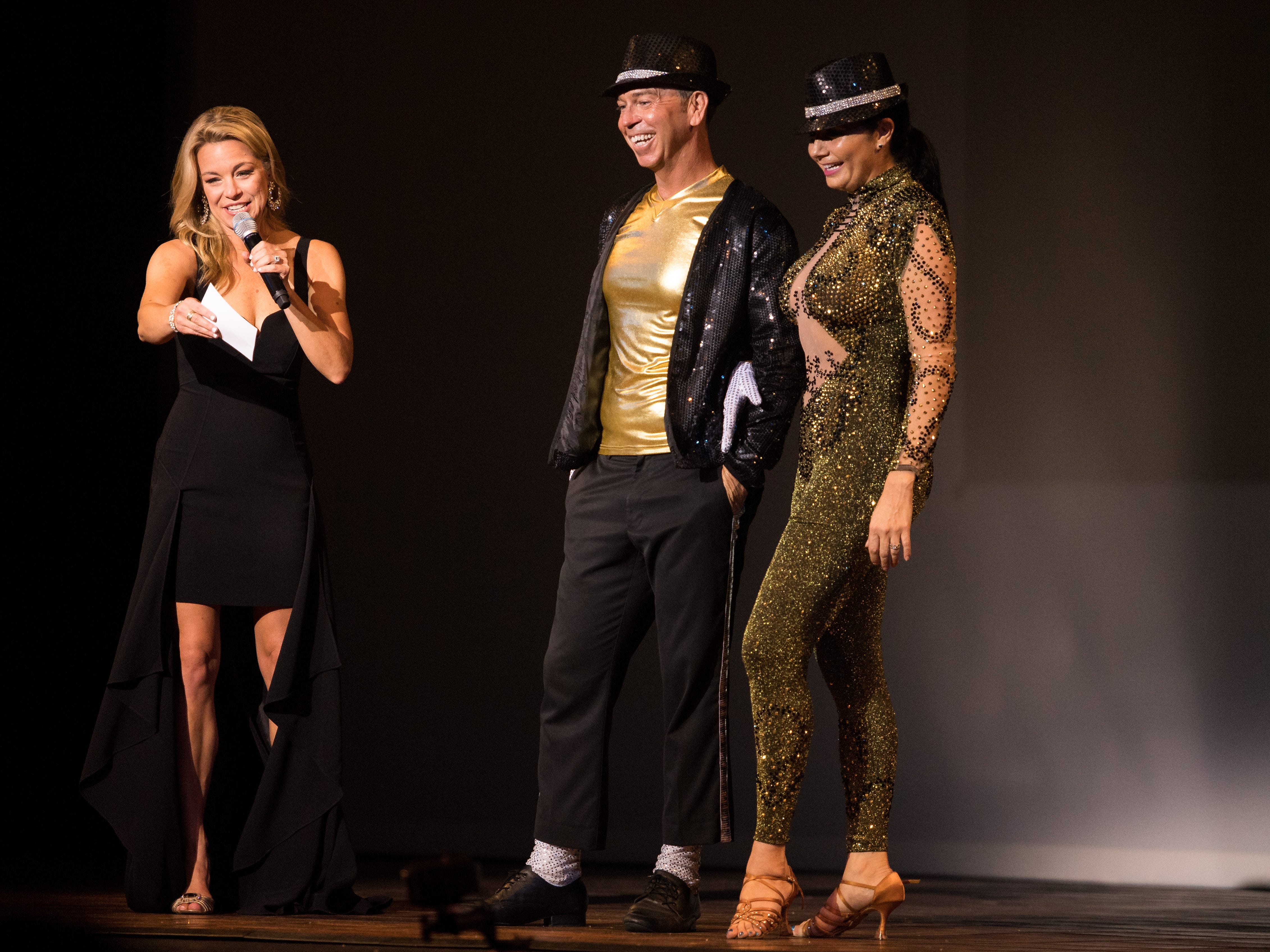 Star dancer Robby Rivas (center) and instructor Marianella Tobar stand with event emcee Tiffany Corr (left) as they await their scores after their Michael Jackson-themed dance routine at the 11th annual Dancing with Vero's Stars on Saturday, May 11, 2019, at Riverside Theatre in Vero Beach. The duo received a perfect score, and were later awarded the mirror ball trophy.