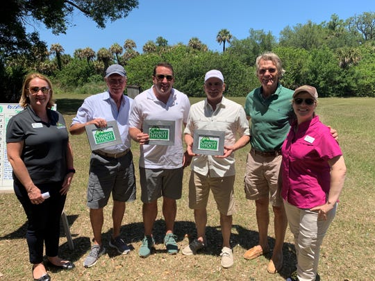 Cynthia Falardeau, CEO of Education Foundation, left, with first-place team Michael Ferrel, Andrew Russell, Charles Piermarini, and Nicky Szapary of the Windsor Gun Club and Pat Blackburn, Education Foundation board member at the Education Foundation of Indian River County's 19th annual Charity Shoot at Windsor's Gun Club.