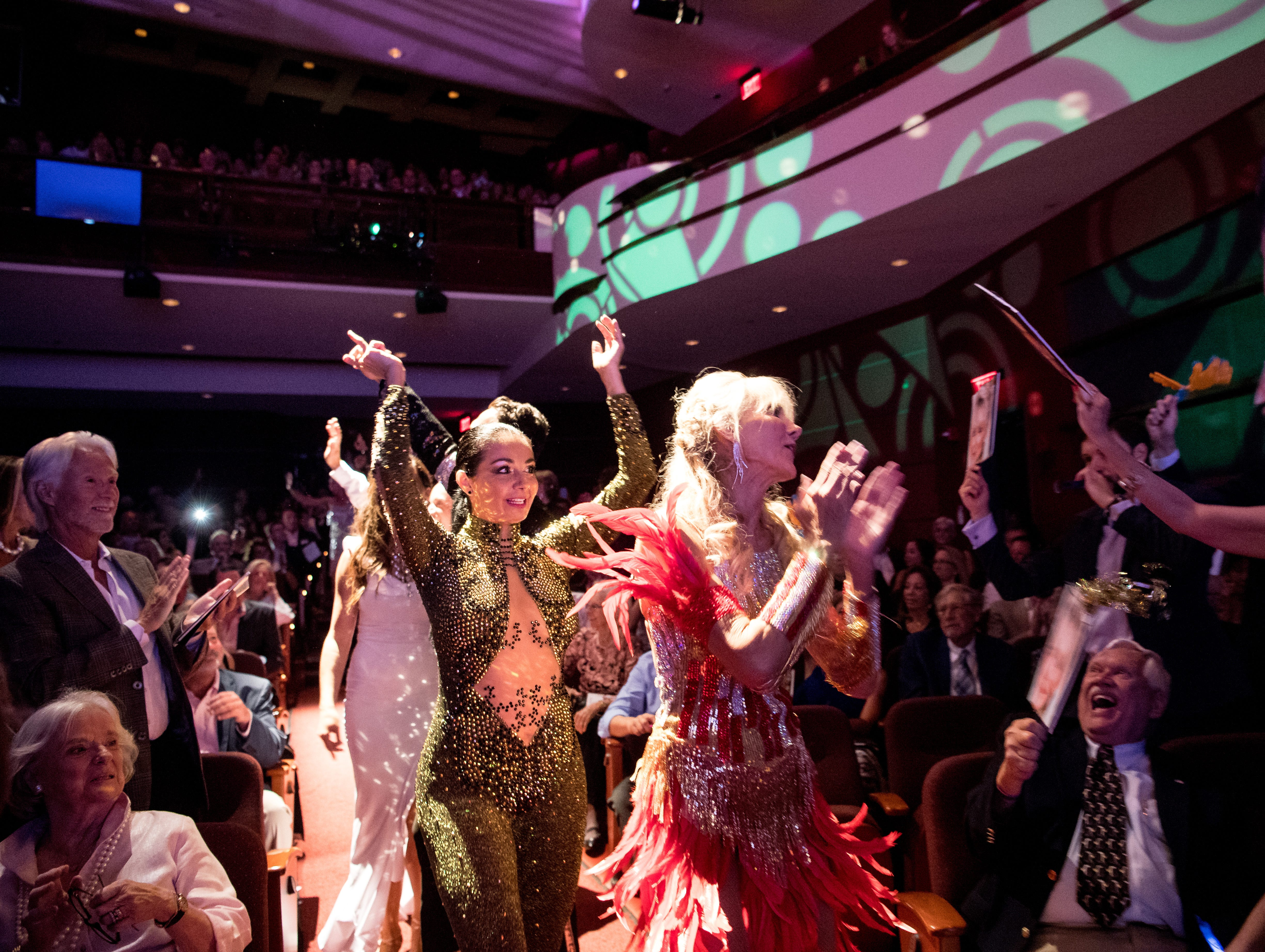 Competitors in the 11th annual Dancing with Vero's Stars — including dance instructor Marianella Tobard (left) and star Pamela DeChellis — are cheered to the stage at the beginning of the show Saturday, May 11, 2019, at Riverside Theatre in Vero Beach. Ten couples competed for a mirror ball trophy during the event, which raised funds for Indian River County Healthy Start Coalition.