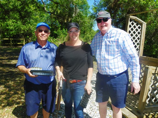 Mark Bondy, Tracey Zudans and Kevin McGill at the Education Foundation of Indian River County's19th annual Charity Shoot at Windsor's Gun Club.