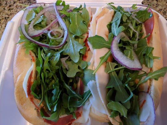 Twisted Pickle's Mama Mia sub is nicely constructed with chicken breast, capicolla, mozzarella, pesto, sun dried tomatoes, fresh arugula, and a bit of red onion.