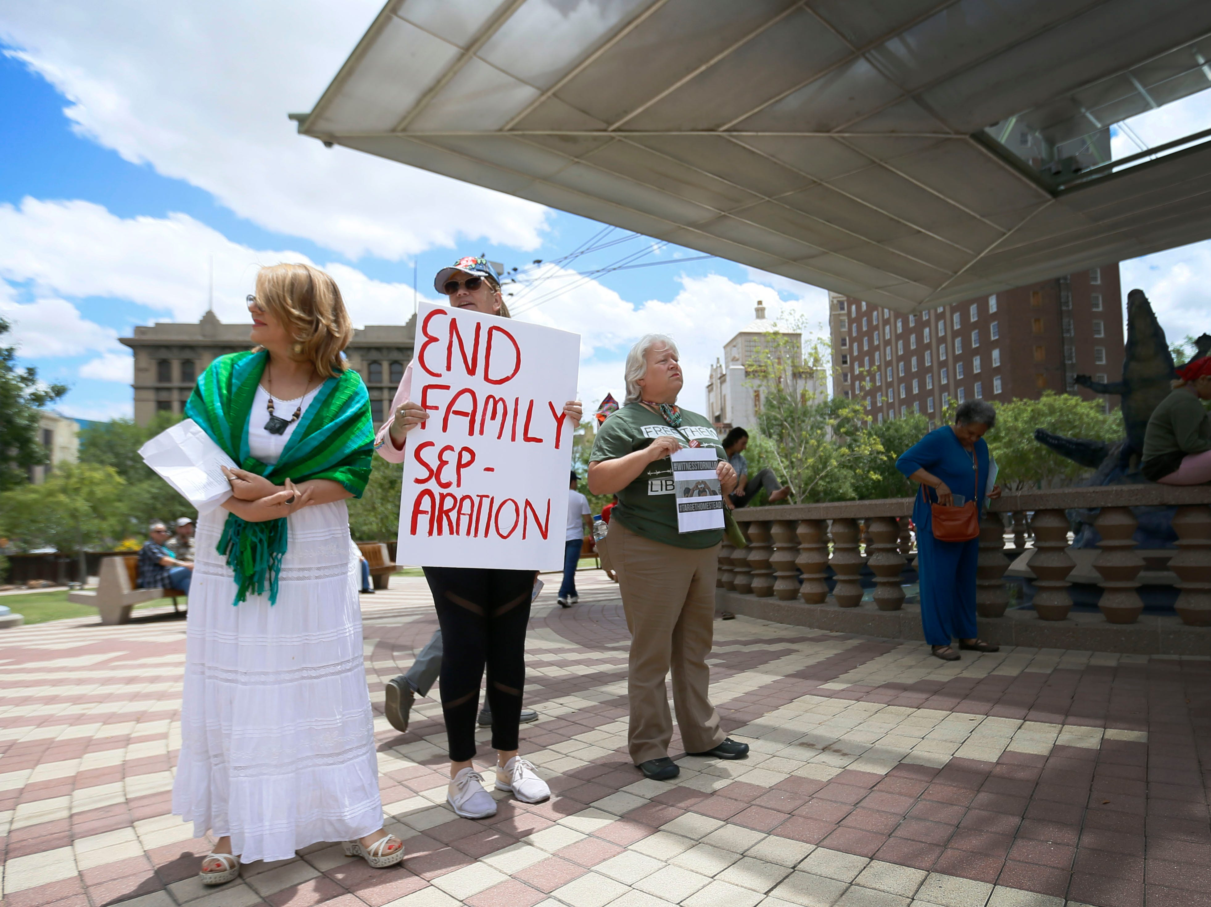 Raquel Mejia, from left, Laraine Schollmann and Lisa McCuller attend the Coalition to End Child Detention - El Paso rally Sunday, May 12, to end family separation and child detention.
