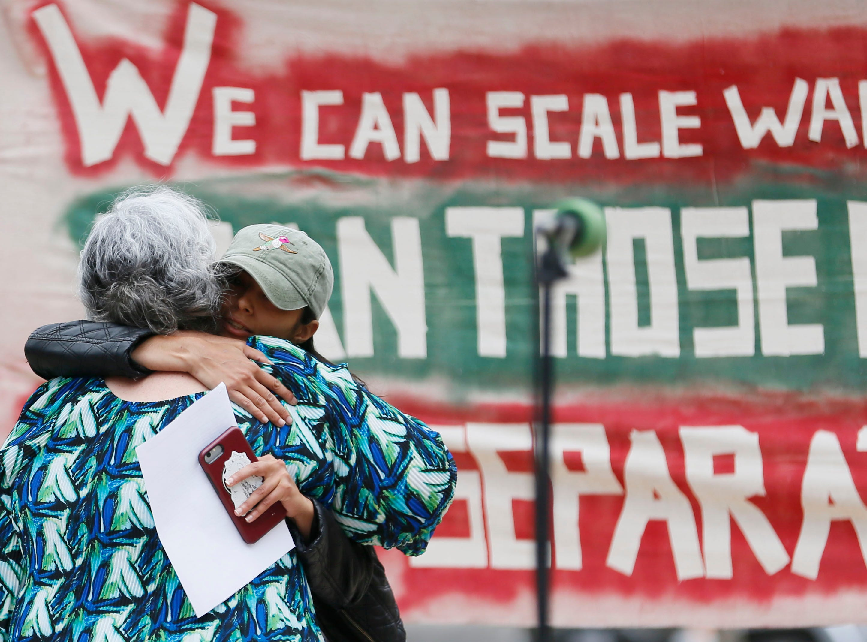 Andrea Martinez, Indivisible El Paso executive director, gives Yolanda Chavez Leyva a hug after her speech during the Coalition to End Child Detention - El Paso rally Sunday, May 12, to end family separation and child detention.