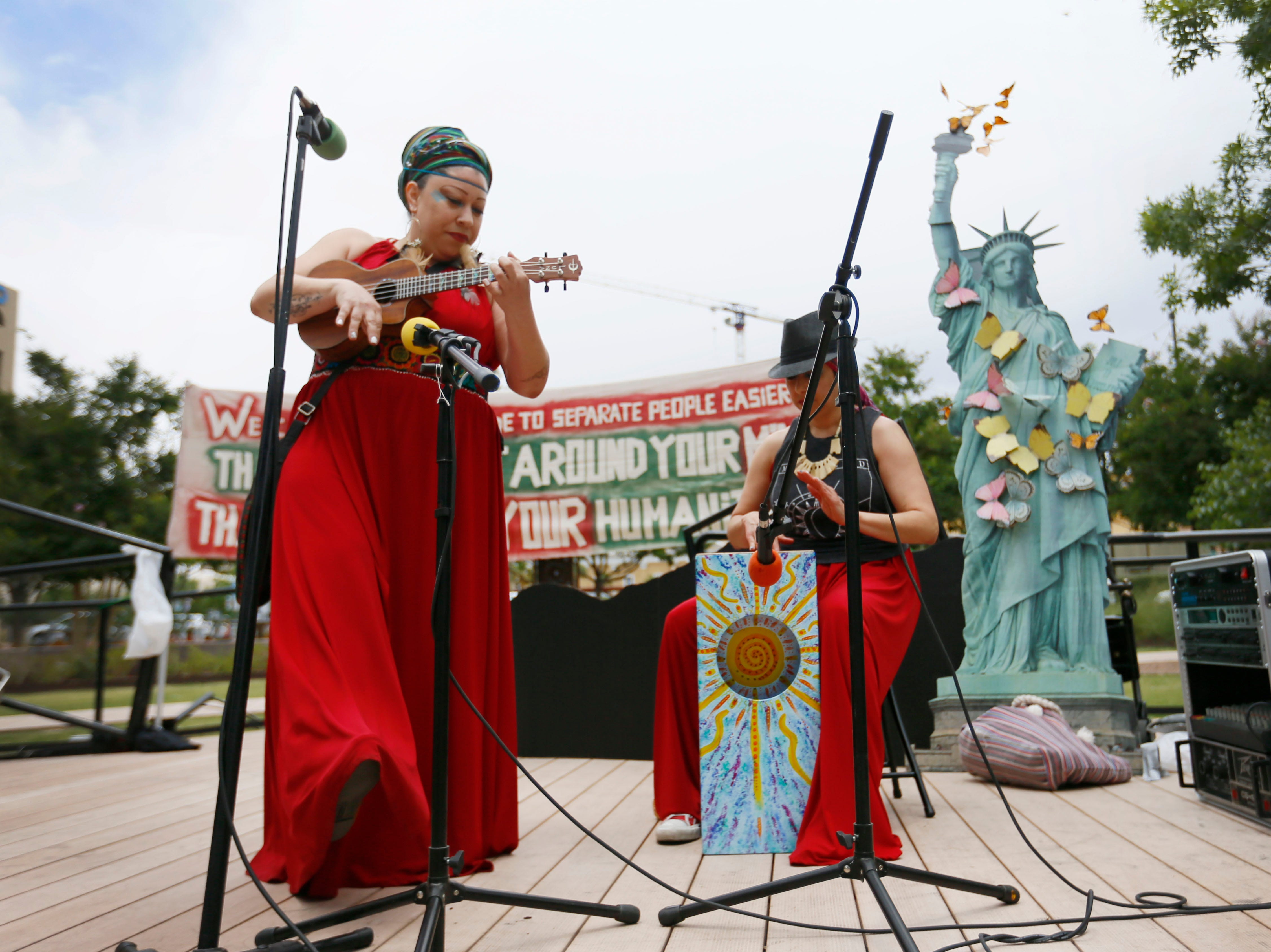 Shaka Took performs during the Coalition to End Child Detention - El Paso rally Sunday, May 12, to end family separation and child detention. Angelica Tinajero, left, and her sister Betsy Tinajero performed several songs during the rally.