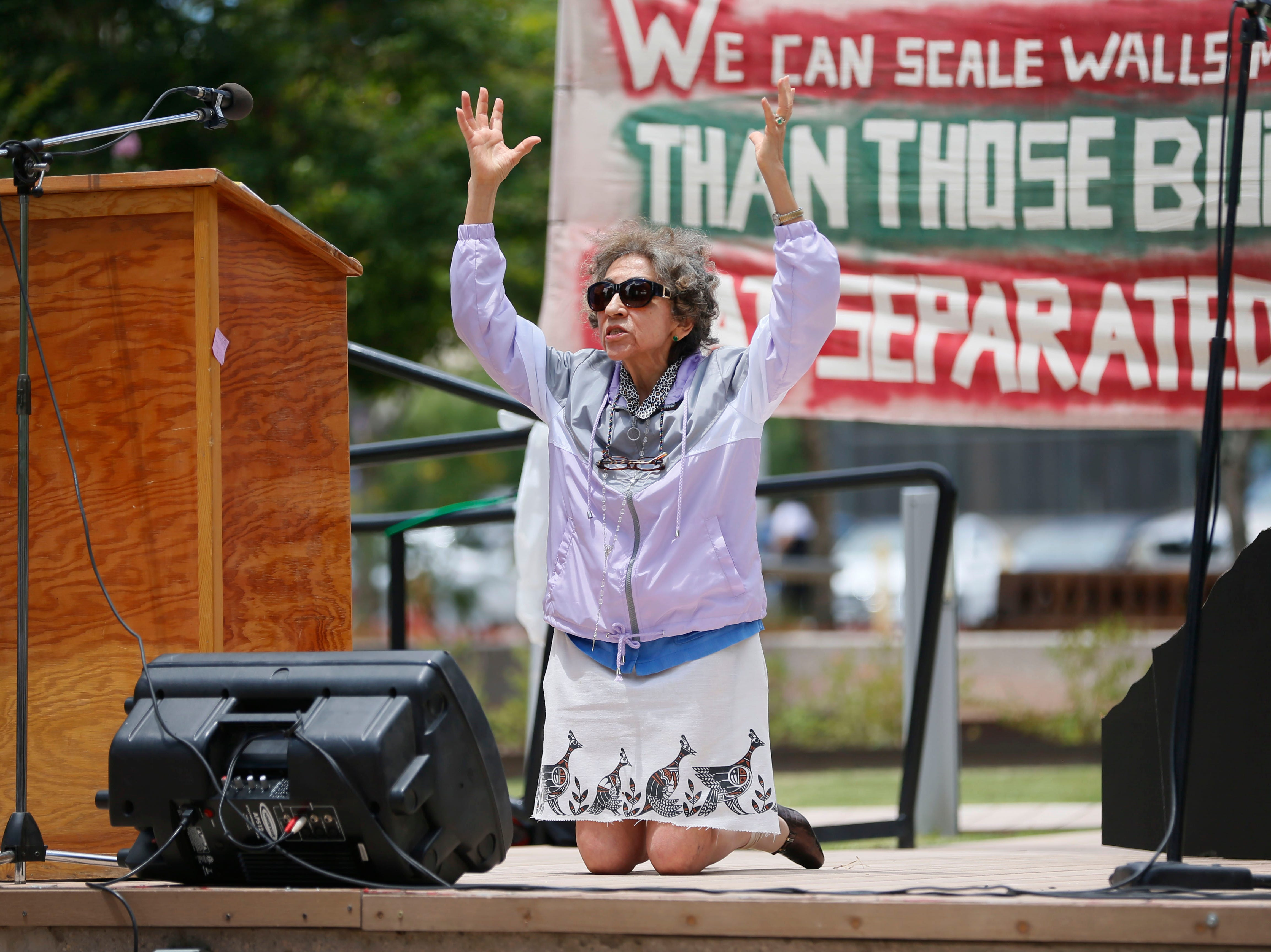 Cordelia Candelaria drops to her knees during her speech at the Coalition to End Child Detention - El Paso rally Sunday, May 12, to end family separation and child detention.
