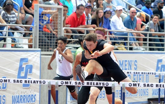 Derek Pekar of Ventura High clears a hurdle during the Division 2 110 hurdles at the CIF-SS Track and Field Championships at El Camino College in Torrance on Saturday. Pekar placed second to help the Ventura boys team win the CIF team title.