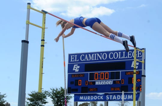 Paige Sommers of Westlake High soars over the bar in the Division 2 pole vault competition at the CIF-SS Track and Field Championships at El Camino College in Torrance on Saturday. Sommers won the pole vault and the high jump titles.