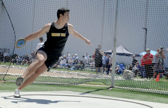 Gino Cruz of Newbury Park High gets ready to throw the the discus at the CIF-Southern Section Track and Field Championships on Saturday at El Camino College in Torrance. Cruz won the Division 1 title with a throw of with a throw of 181 feet, 4 inches.