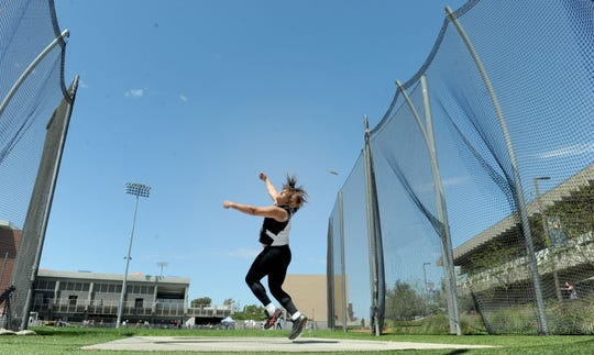 Carlos Aviles of Ventura High lets it fly during the Division 2 discus competition at the CIF-SS Track and Field Championships at El Camino College in Torrance on Saturday. Aviles placed second in the discus and shot put.