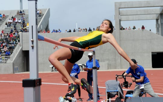 Gedney Quynh of Moorpark stretches to clear the bar in the Division 2 high jump competition at the CIF-SS Track and Field Championships at El Camino College in Torrance on Saturday. Quynh placed fourth.